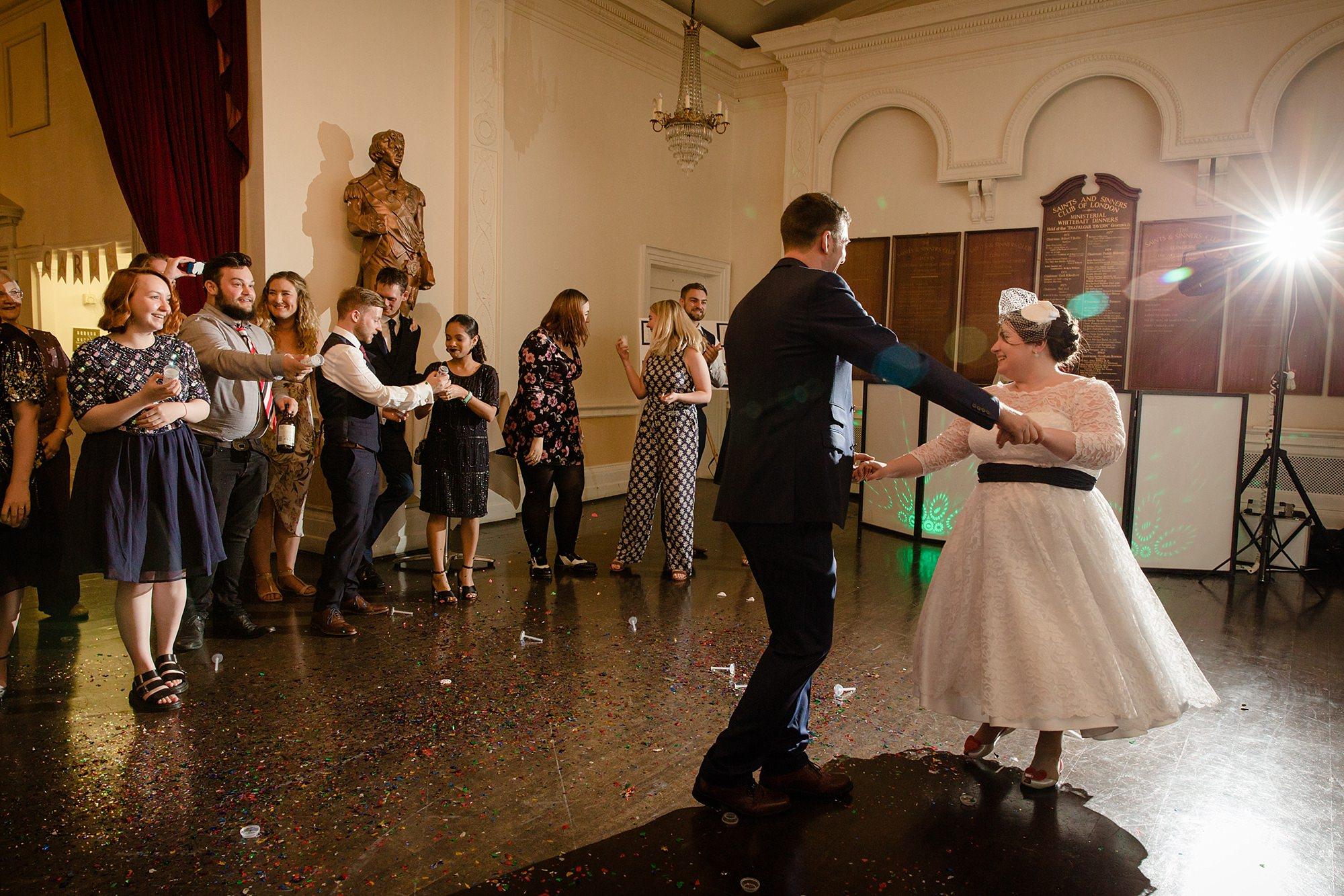 Trafalgar Tavern wedding guests shoot confetti canons during first dance
