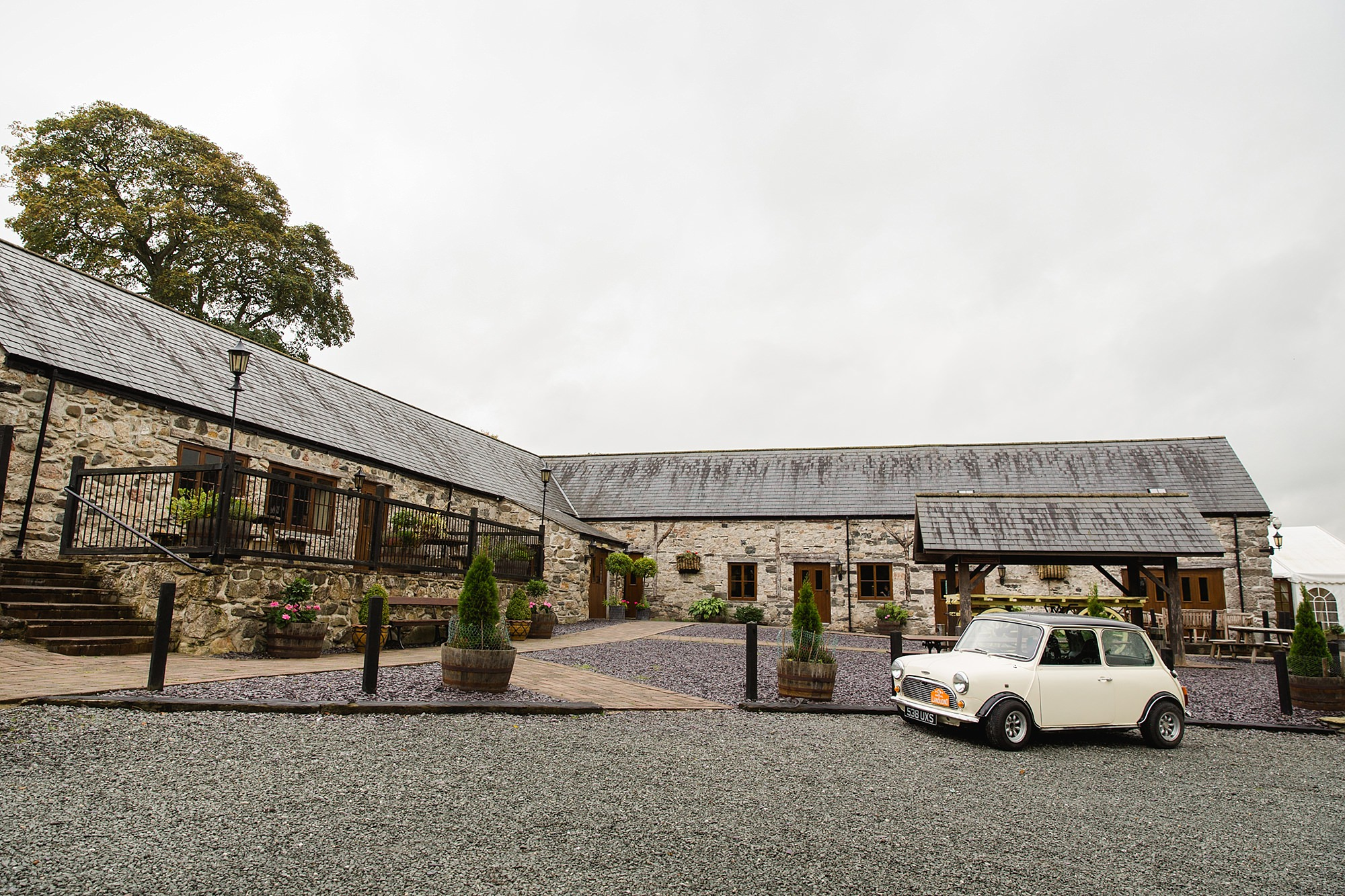 A fun wedding at Plas Isaf with a Mini Cooper
