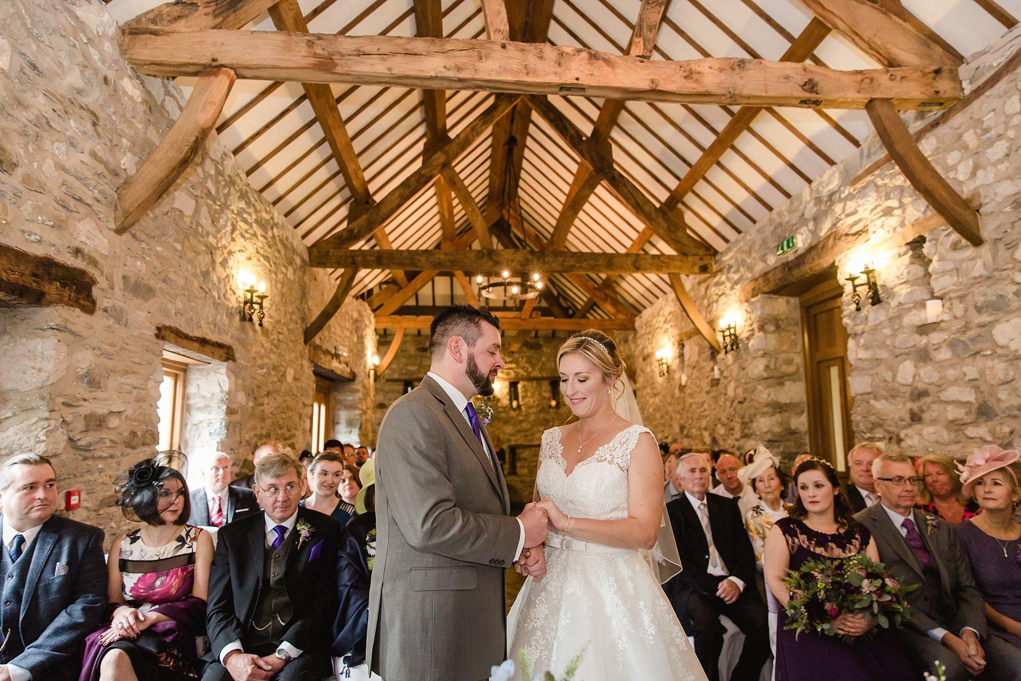A fun wedding at Plas Isaf - bride and groom exchange rings