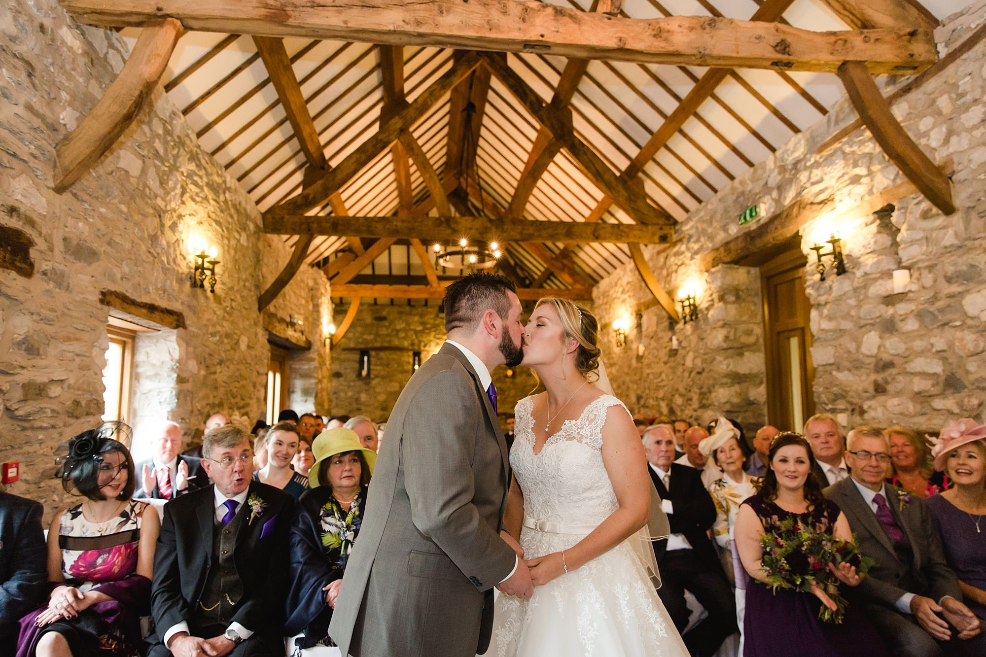 A fun wedding bride and groom kiss at Plas Isaf ceremony
