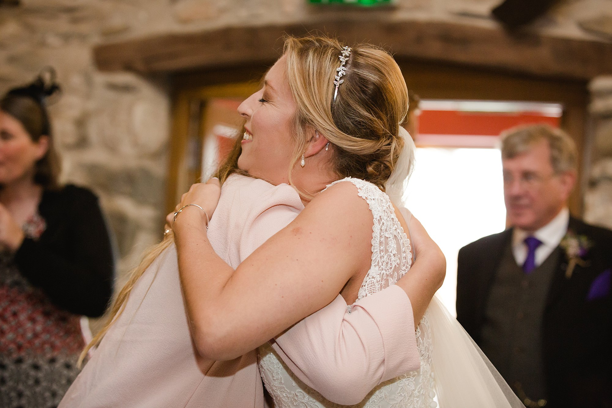 A fun wedding at Plas Isaf wedding goes hugs bride