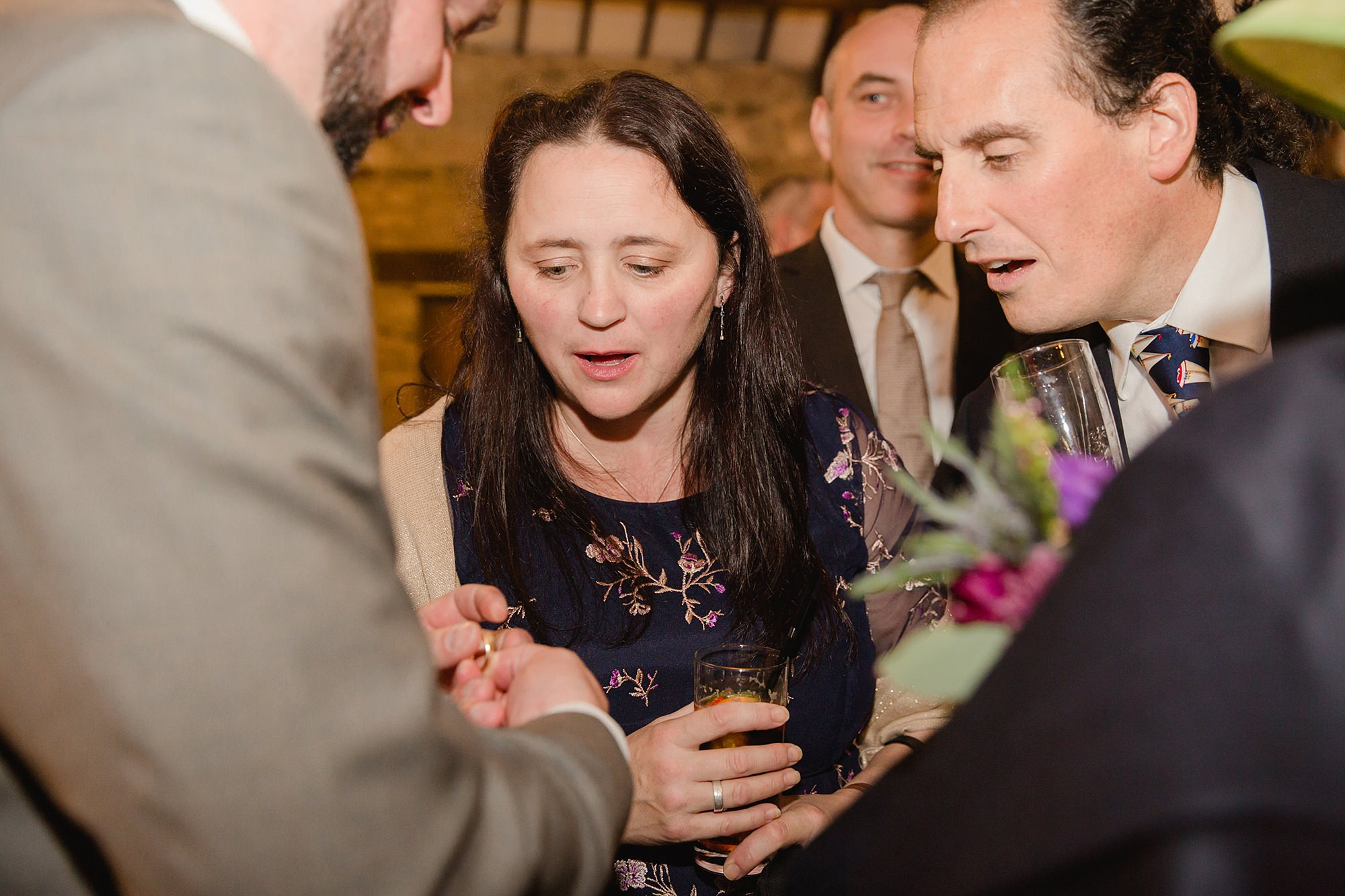 A fun wedding at Plas Isaf - groom showing off his ring