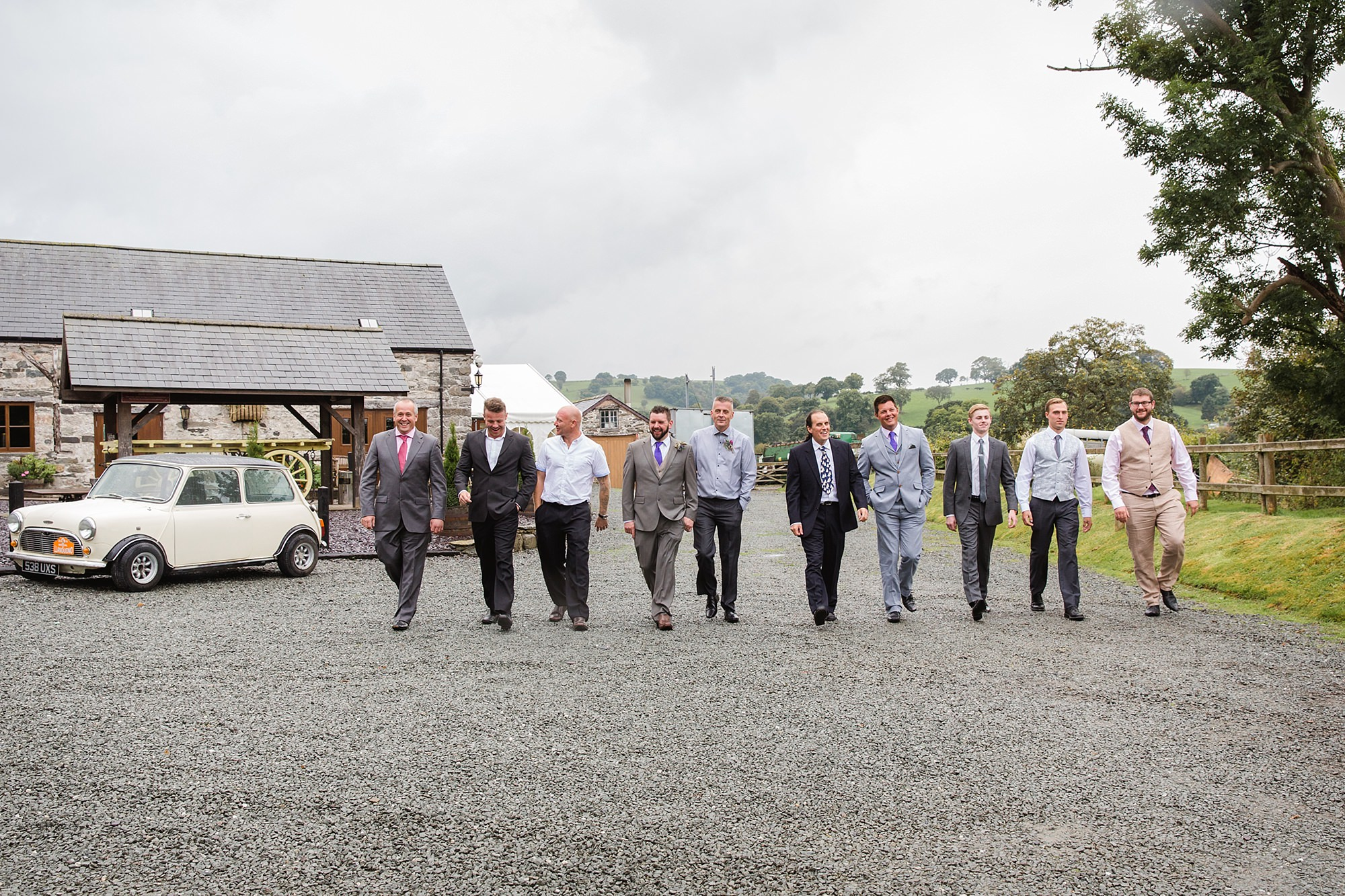 A fun wedding at Plas Isaf - groom and friends walking shot