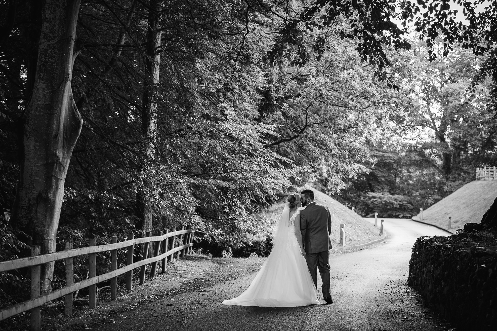 A fun wedding at Plas Isaf bride and groom portrait under trees