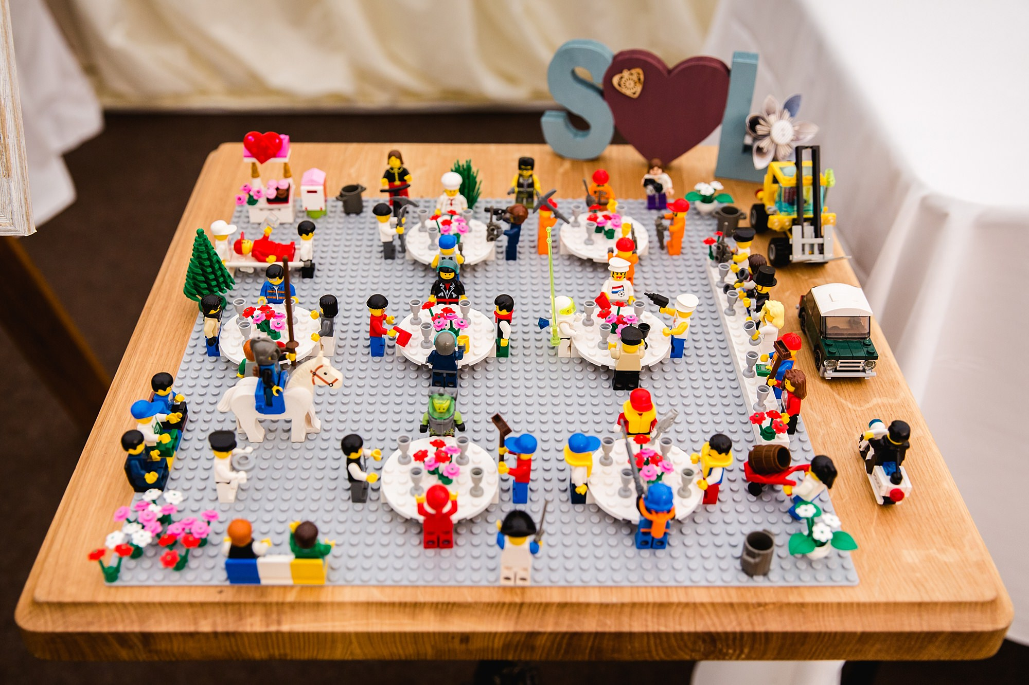 A fun wedding lego table plan at Plas Isaf wedding