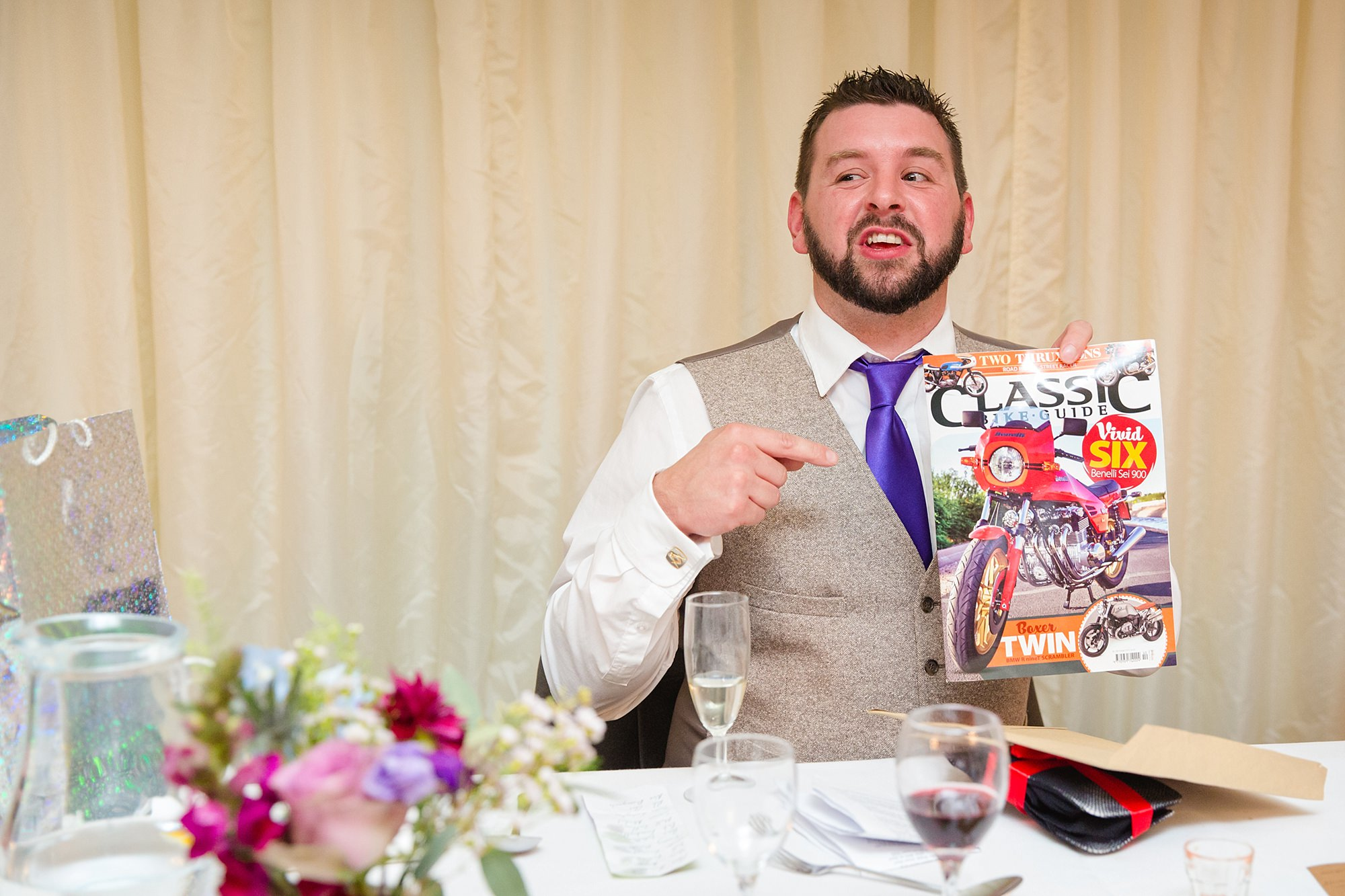 A fun wedding gift from best man shown off by the groom