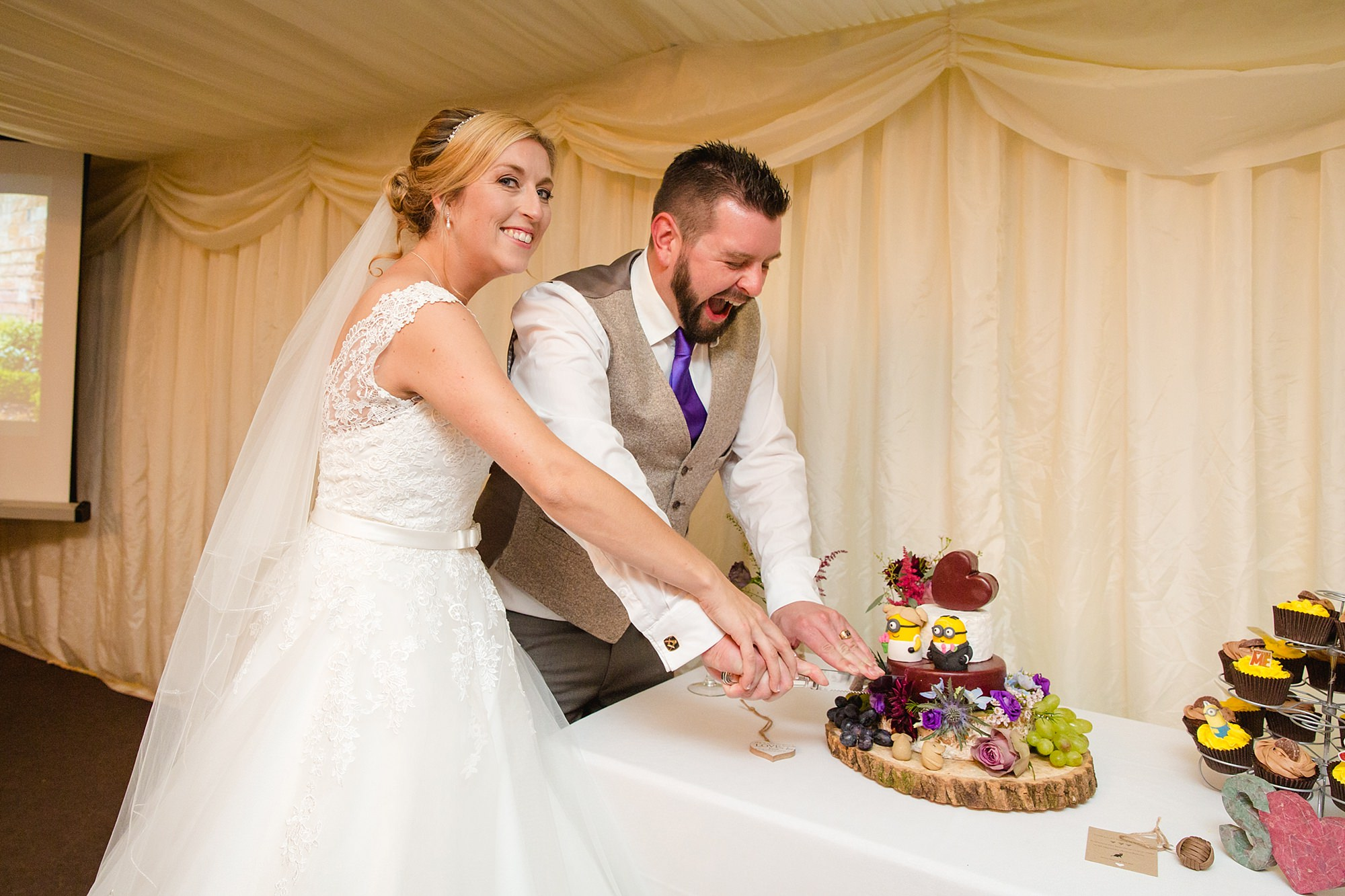 A fun wedding portrait of cake cutting