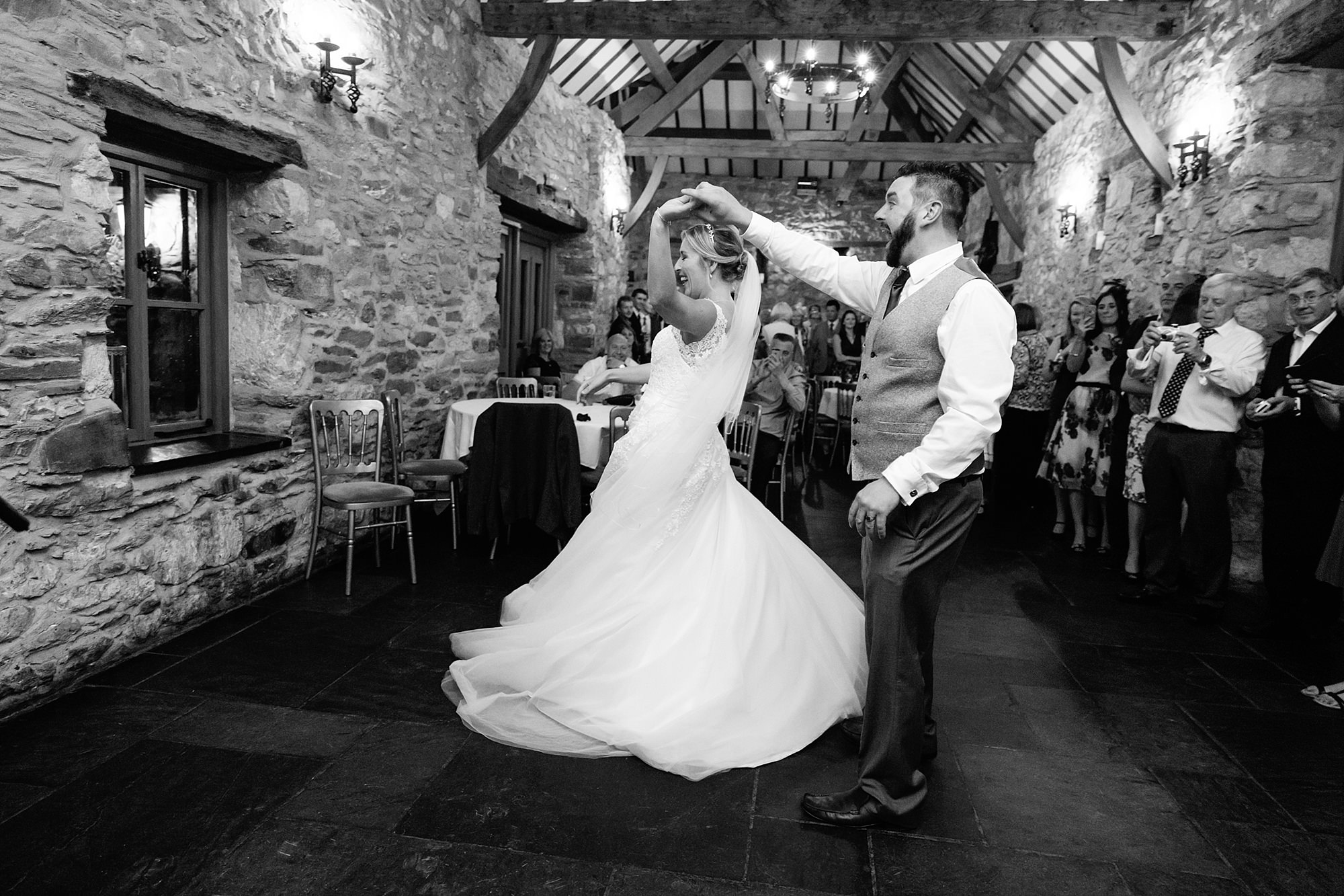 A fun wedding dance at plas Isaf - groom twirls bride