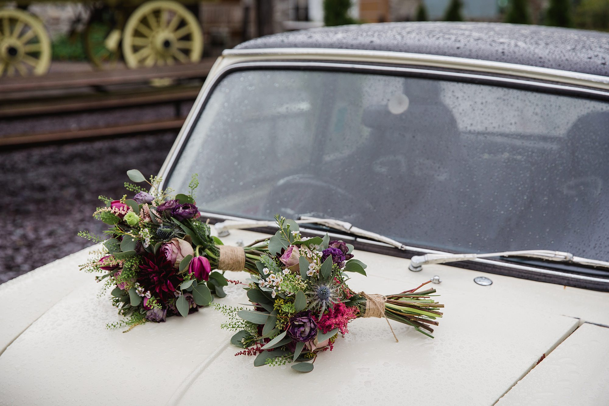 A fun wedding picture of bride's bouquet on mini cooper