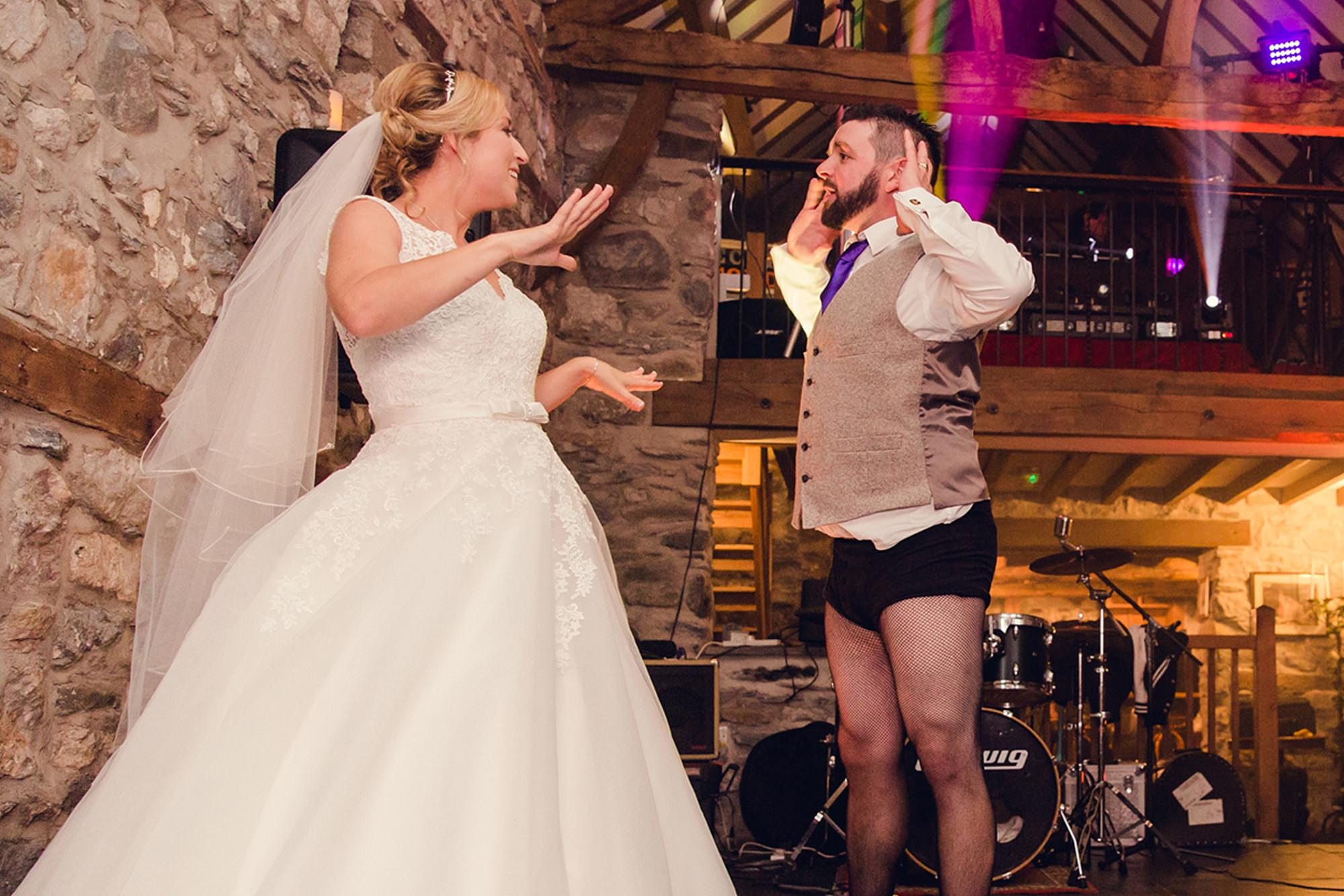 A fun wedding - bride and groom dance to the timewarp in fishnets