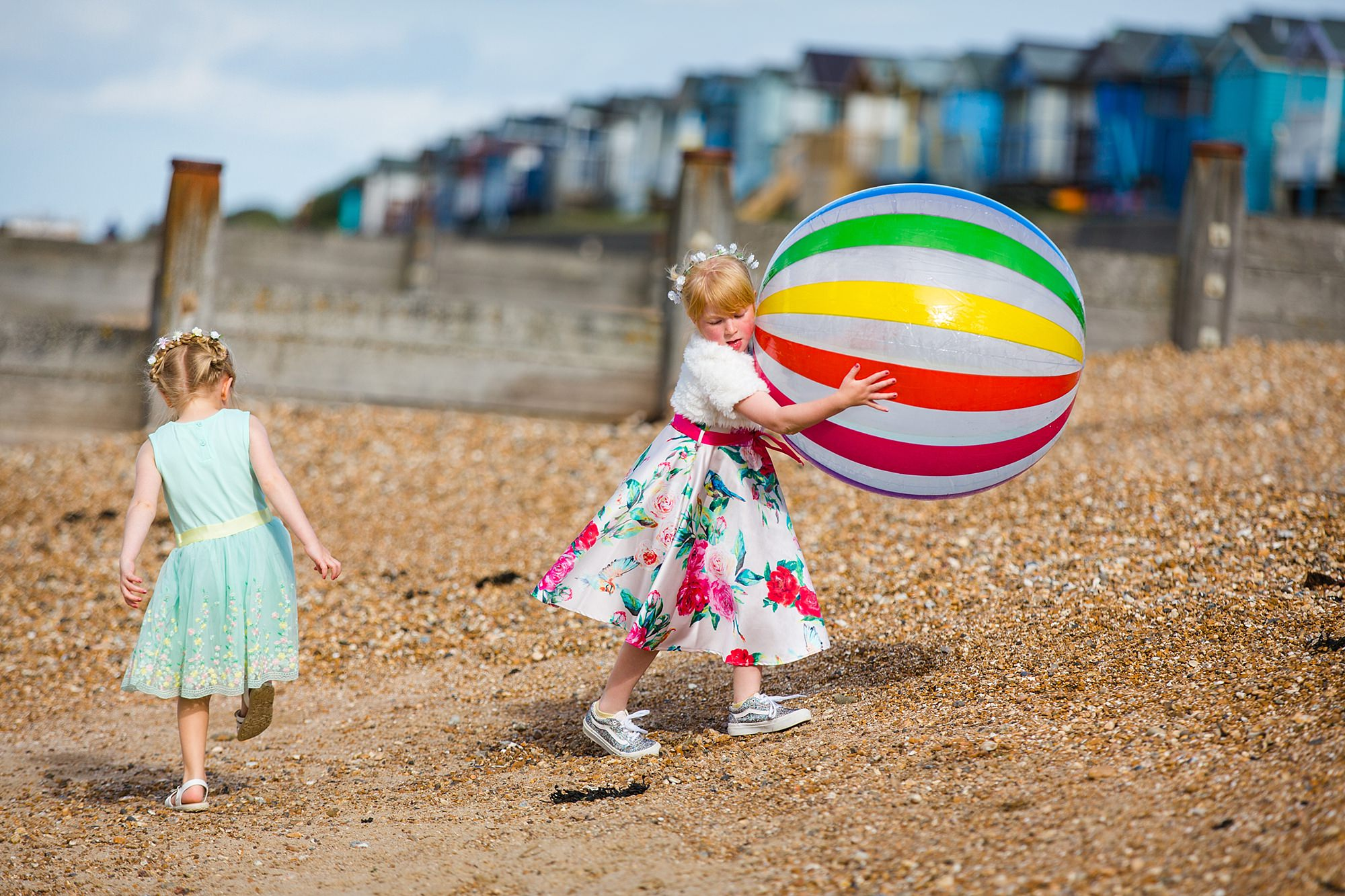 Beacon House wedding flower girl carrying giant beach ball