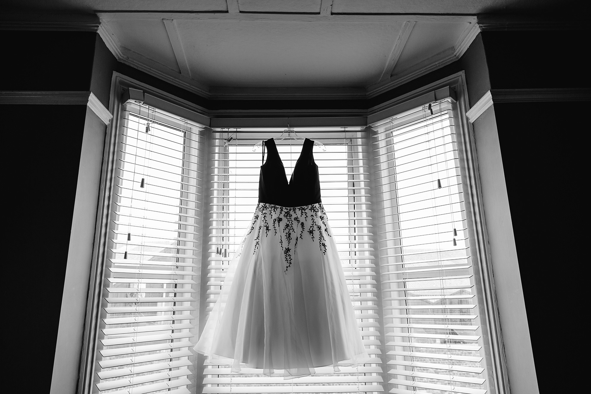 Beacon House wedding image of a wedding dress hung in a window