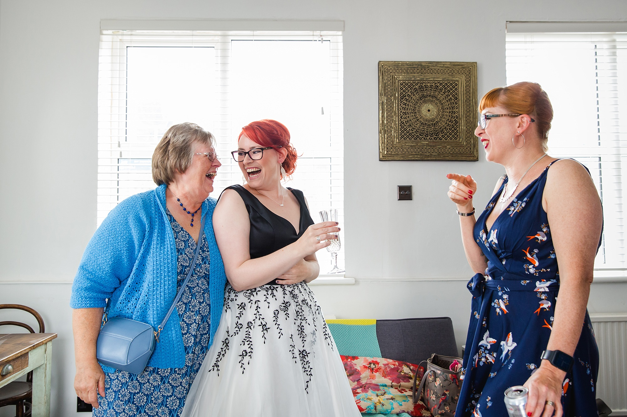 Beacon House wedding portrait of bride laughing with her mum and sister