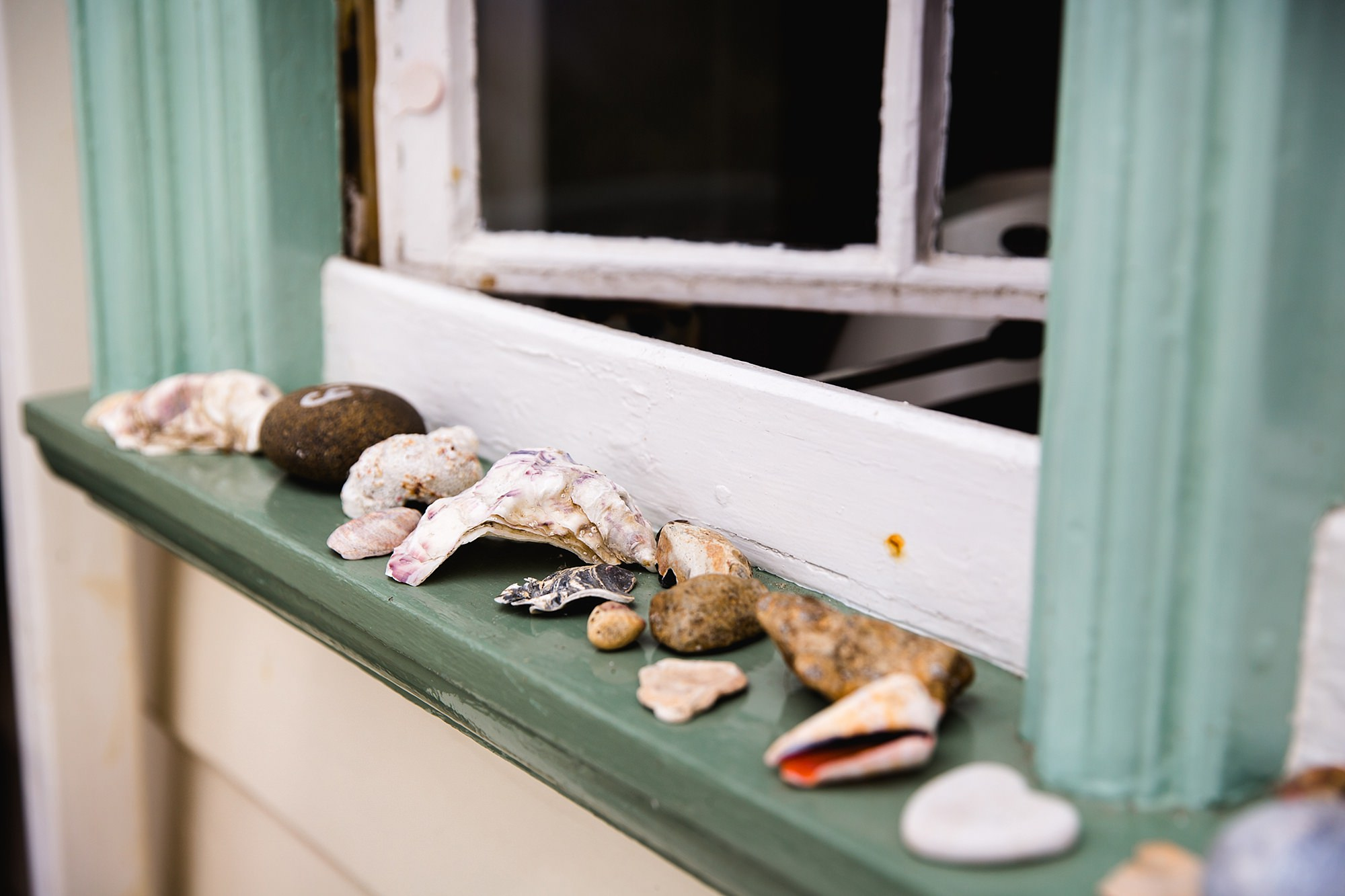 Beacon House wedding detail shot of seashells lining a window at beacon house