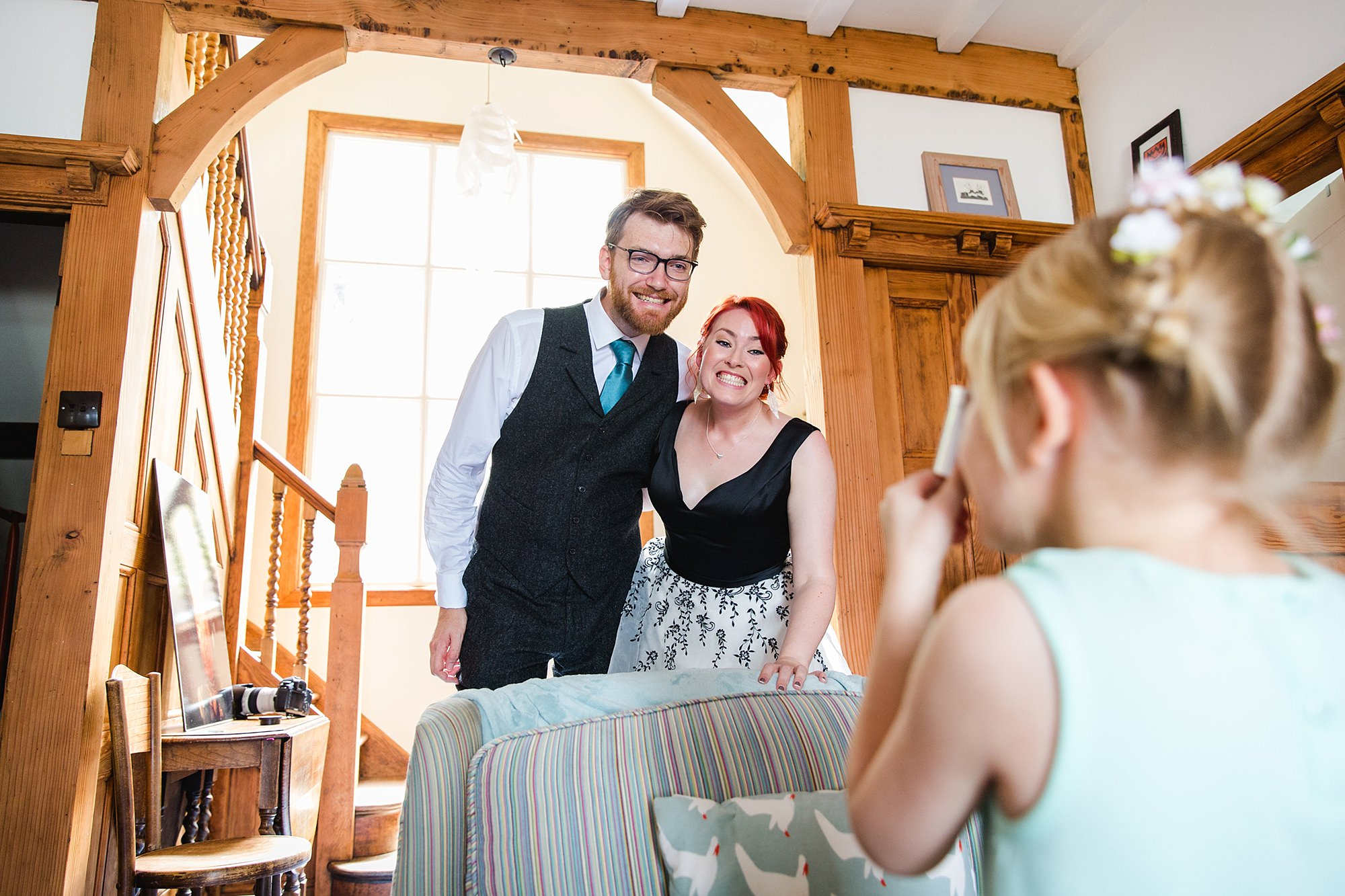 Beacon House wedding a guest takes a picture of the bride and groom