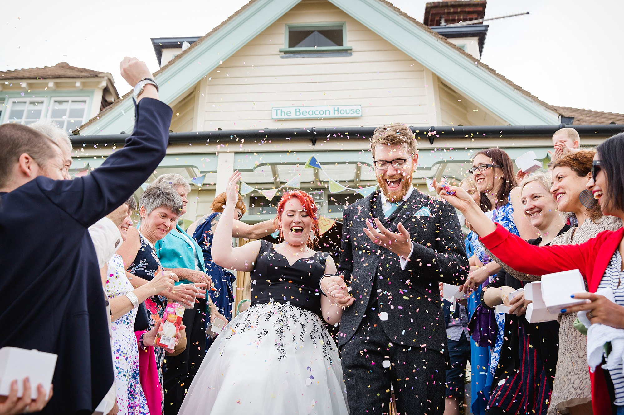 Beacon House wedding bride and groom walk through confetti