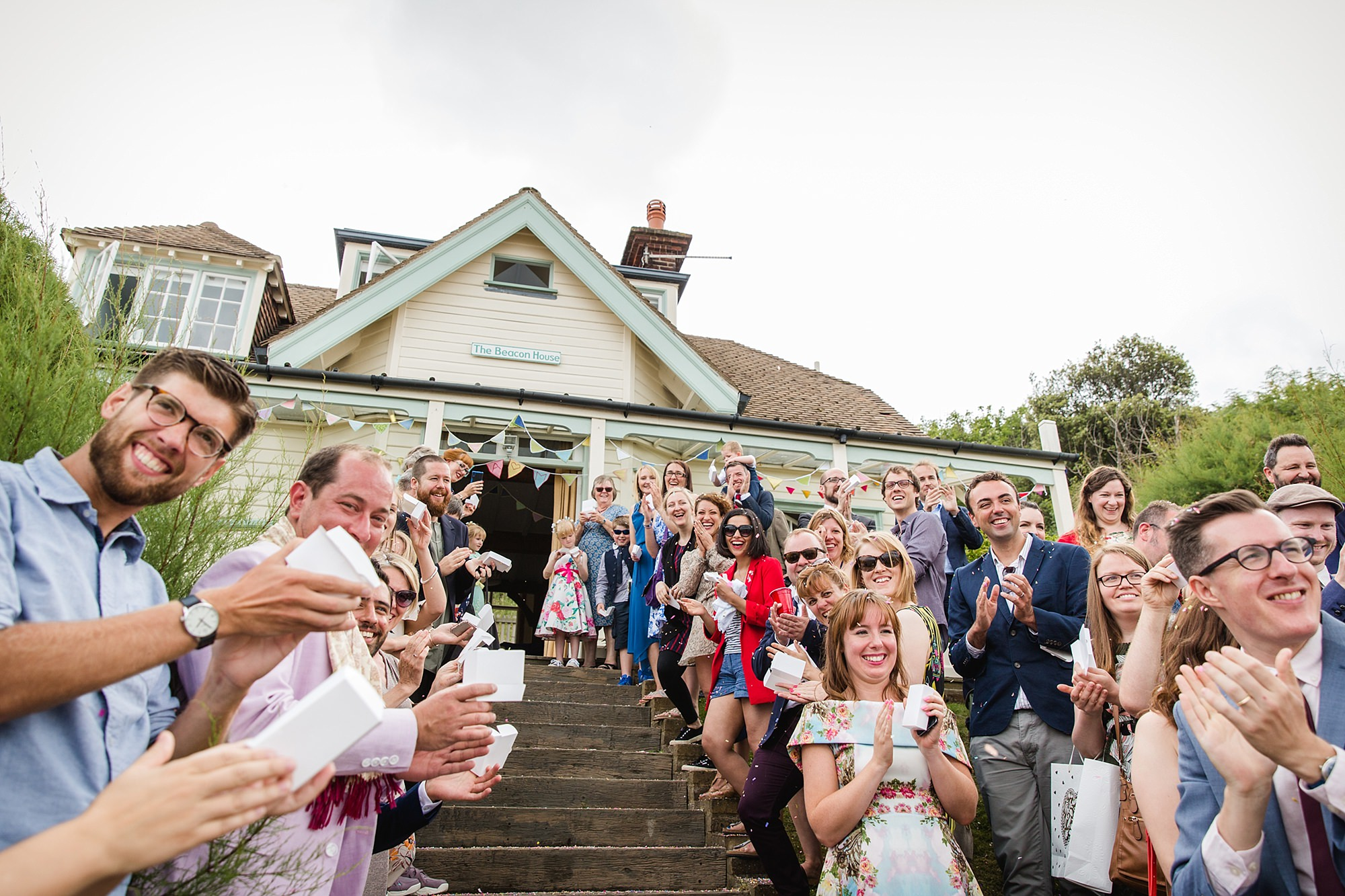 Beacon House wedding guests cheer on bride and groom