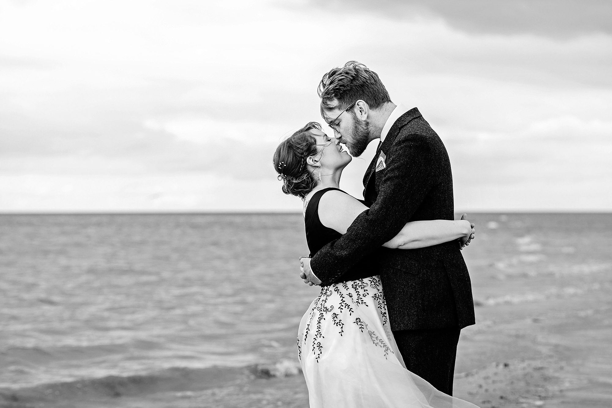 Beacon House wedding bride and groom hug tightly on the beach in whitstable