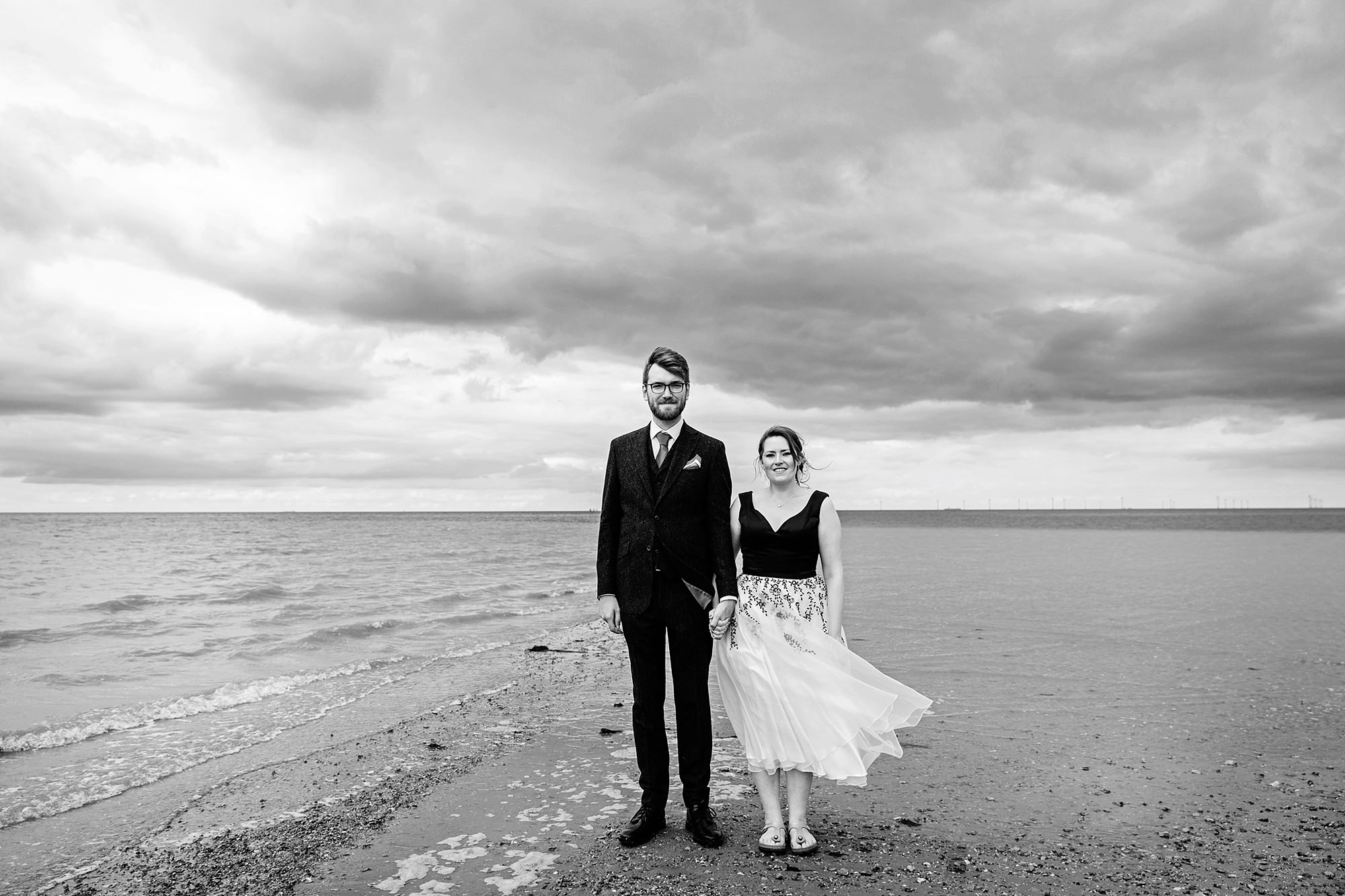 Beacon House wedding bride and groom stood together on whitstable beach