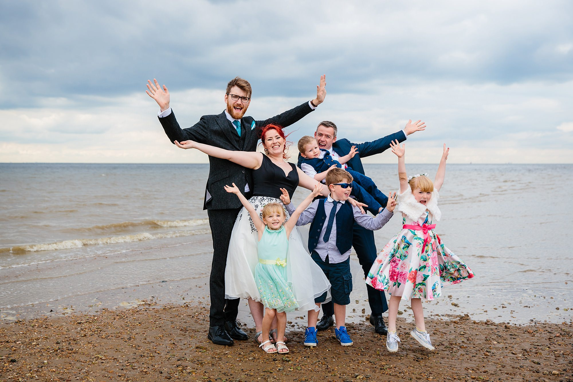 Beacon House wedding fun family portrait on the beach