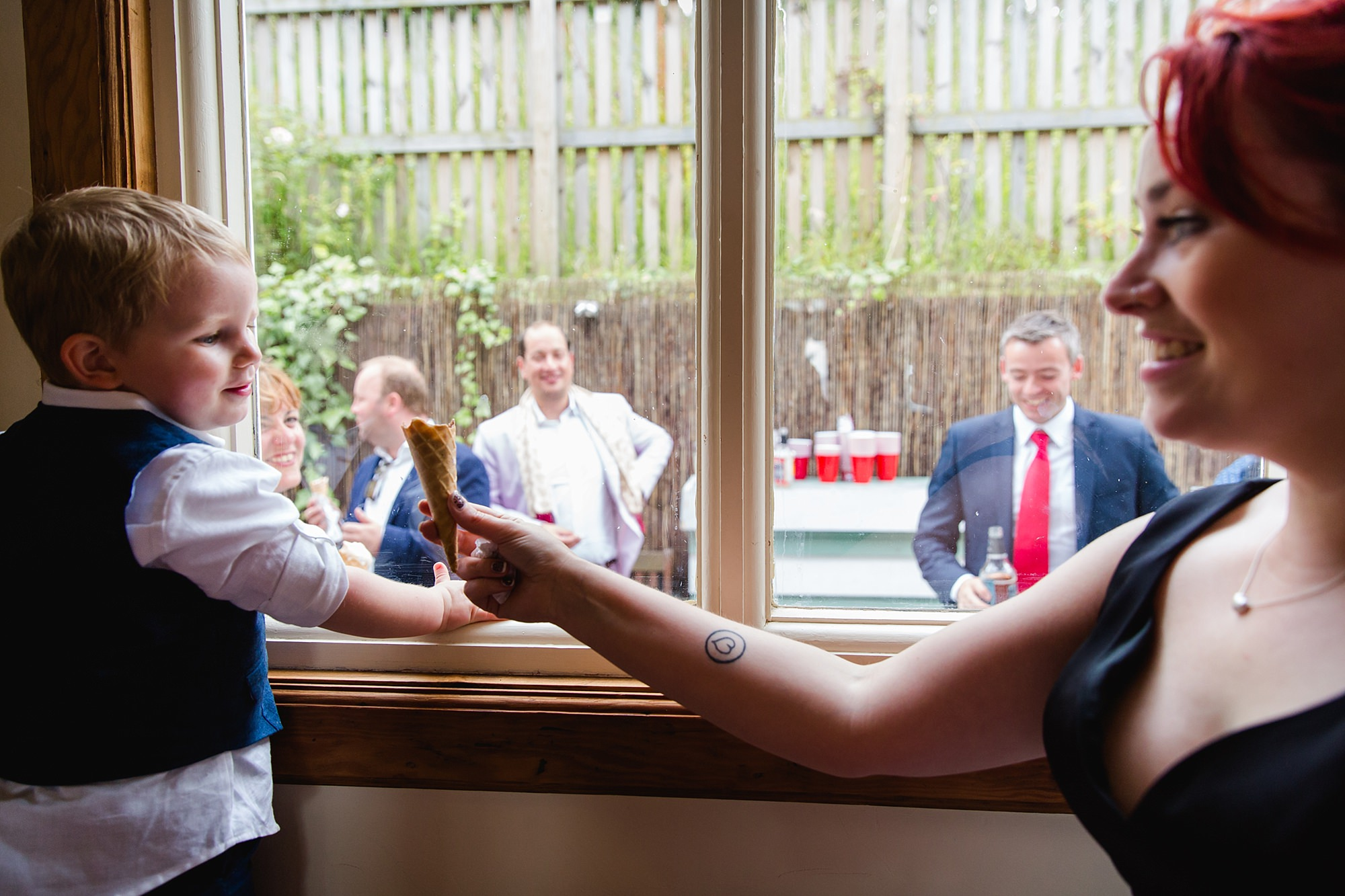 Beacon House wedding bride gives her ice cream cone to a guest