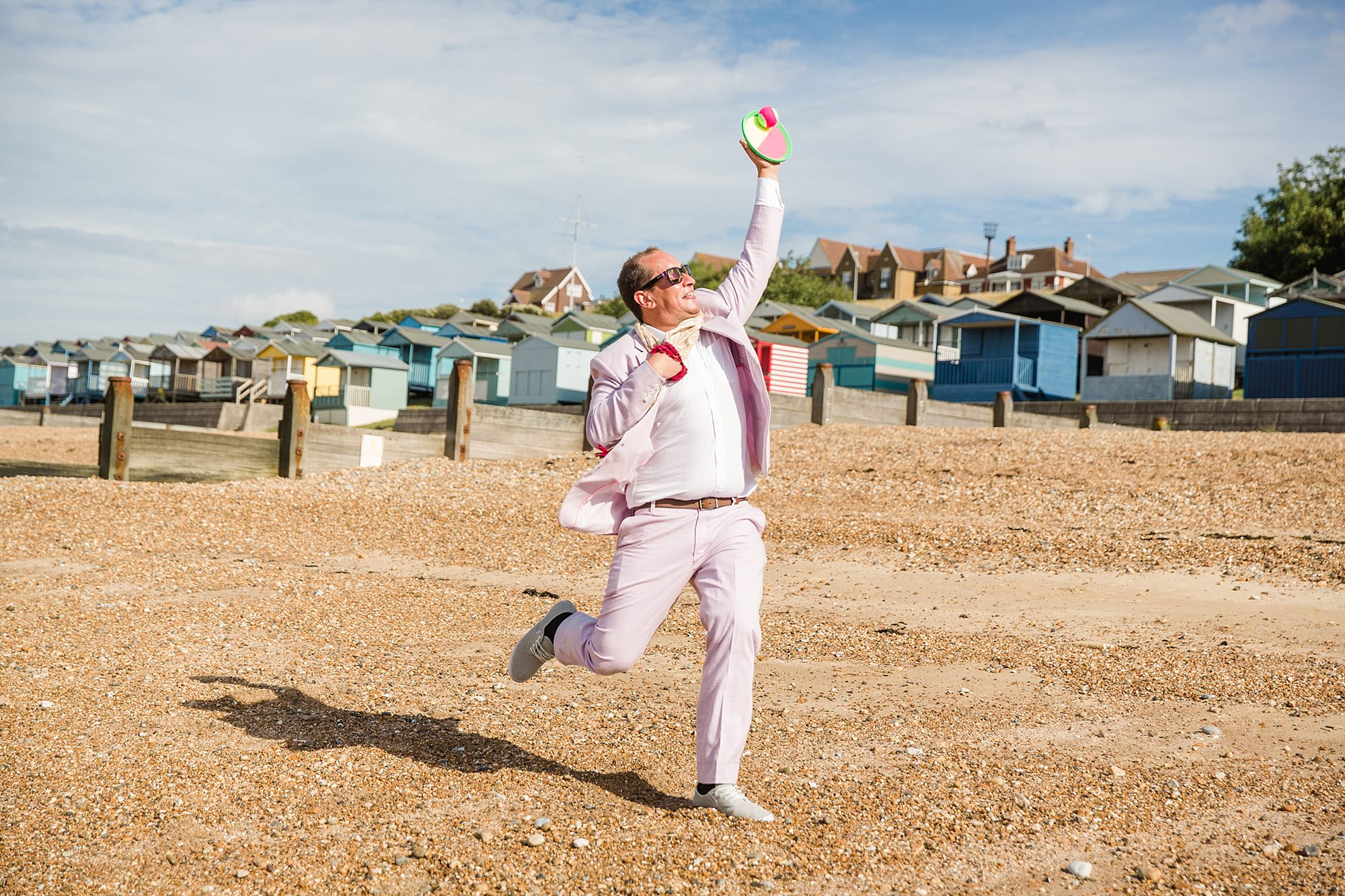 Beacon House wedding guest playing catch on the beach