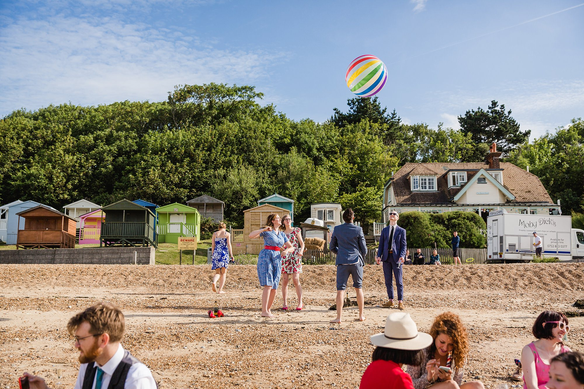 Beacon House wedding guests playing with beach ball