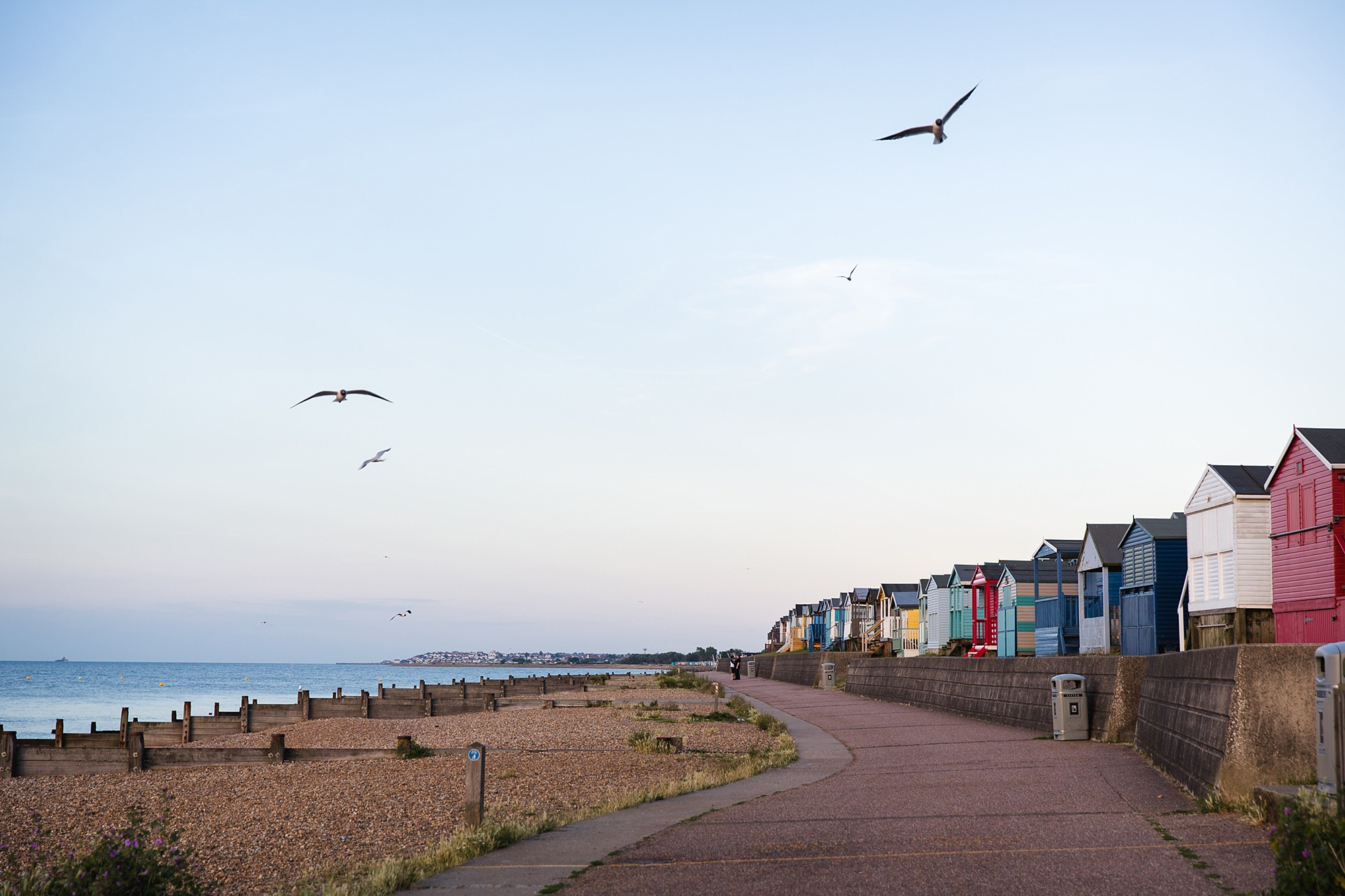 Beacon House wedding view of beach huts in the evening