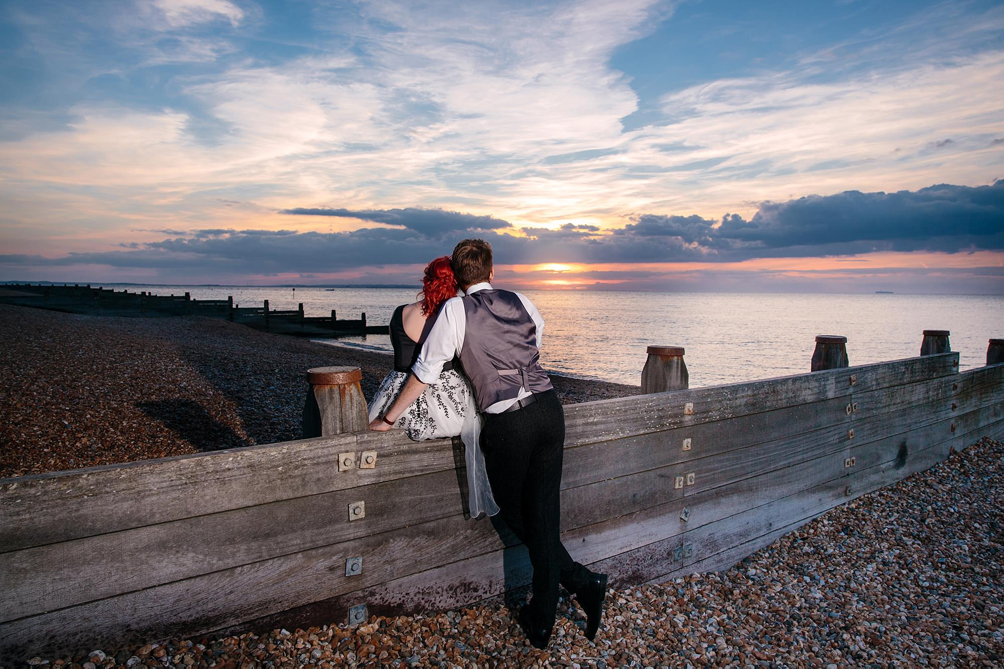 Beacon House wedding bride and groom watch the sunset on whitstable beach