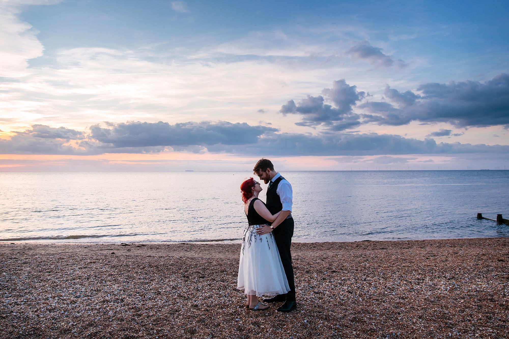 Beacon House wedding bride and broom pose on whitstable beach at sunset