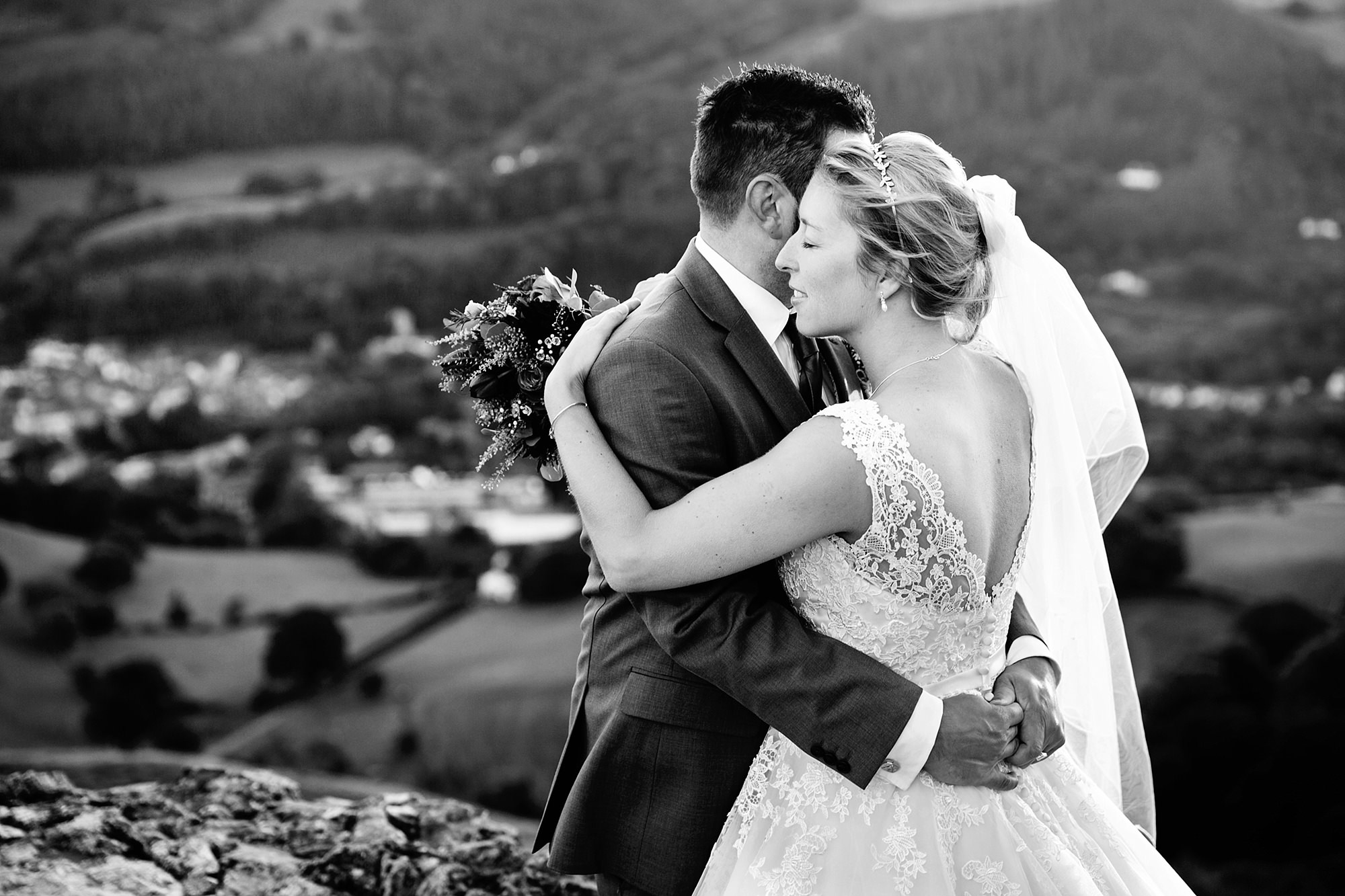 Castell dinas bran wedding photography portrait of bride and groom hugging