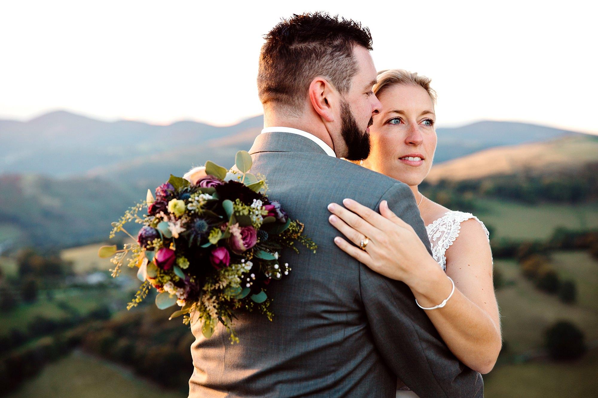 Castell dinas bran wedding photography a bride looks over the landscape at llangollen