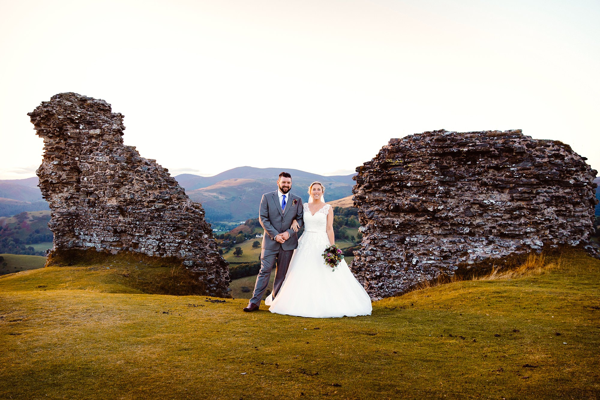 Castell dinas bran wedding photography portrait of bride and groom stood together at castle ruins