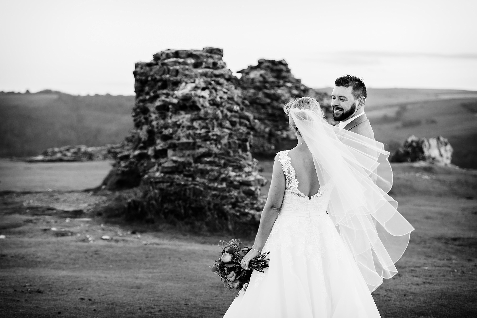 Castell dinas bran wedding photography portrait of groom laughing at his bride