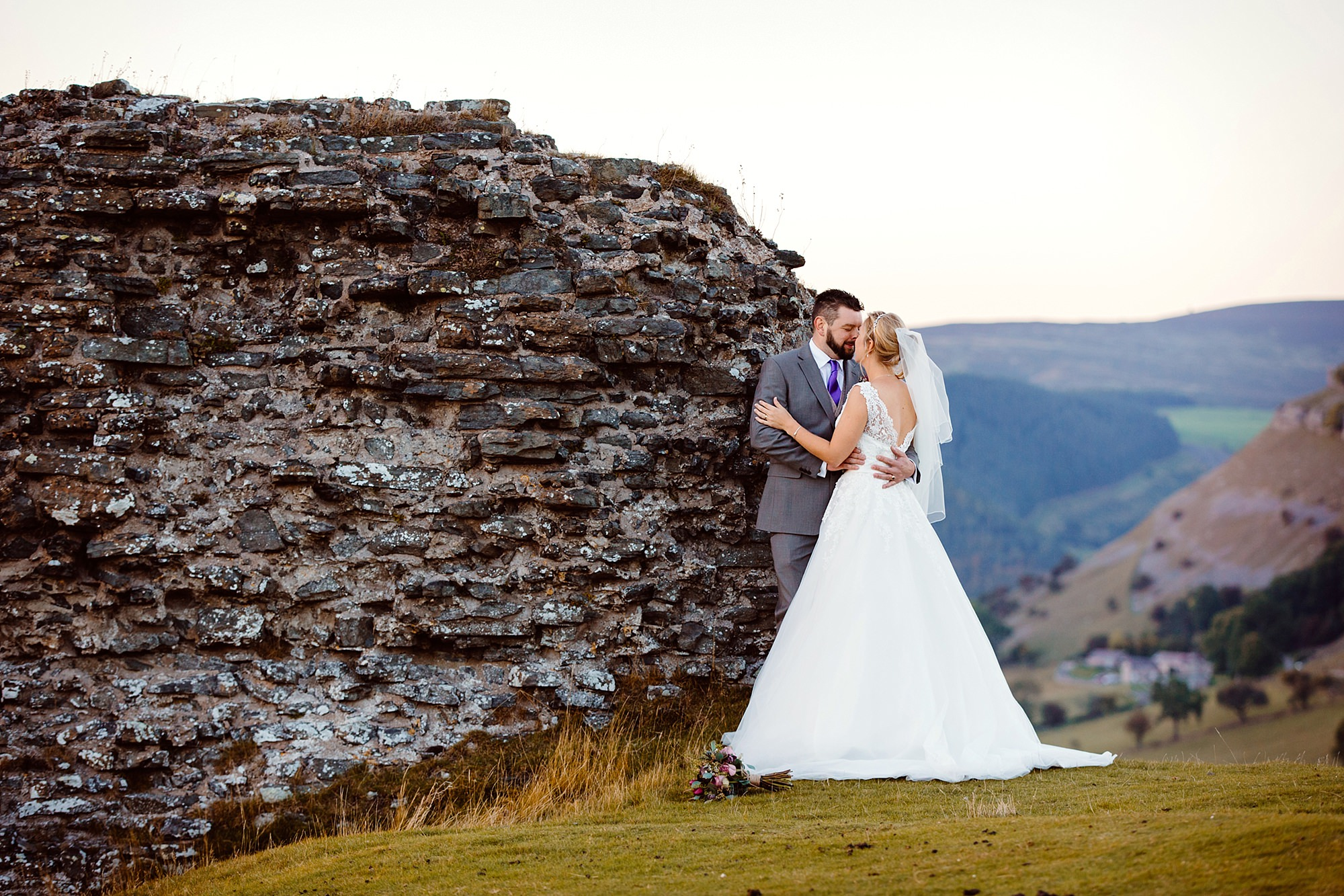 Castell dinas bran wedding photography portrait of bride and groom on top of a hill in llangollen