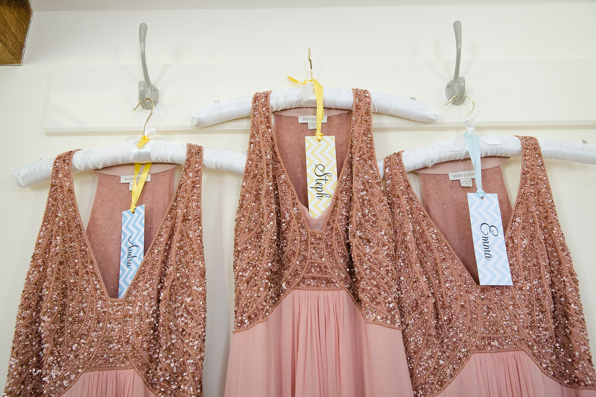 Caswell House Wedding sequin bridesmaid dresses hung up
