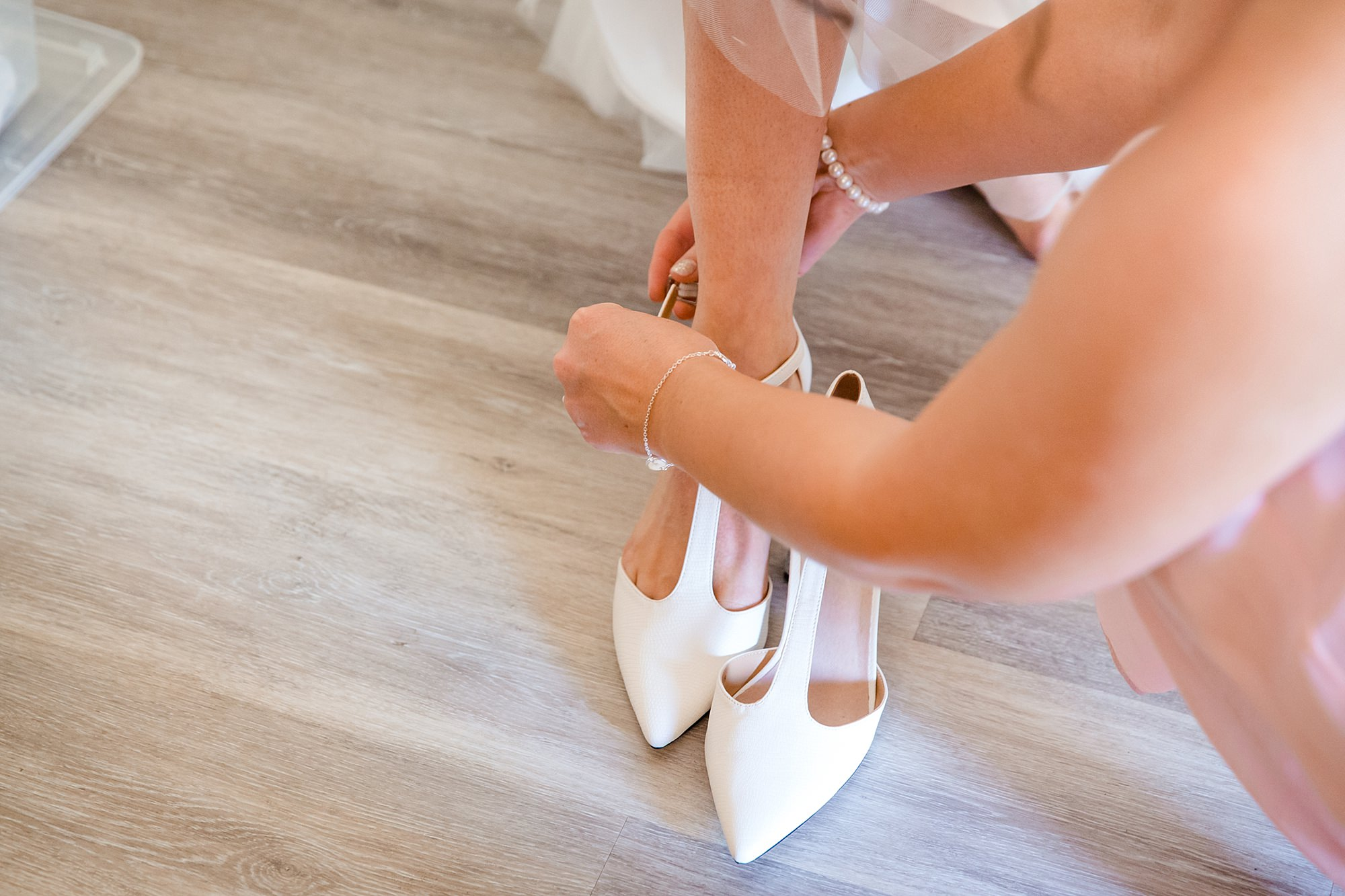 Caswell House Wedding bride puts on her shoes