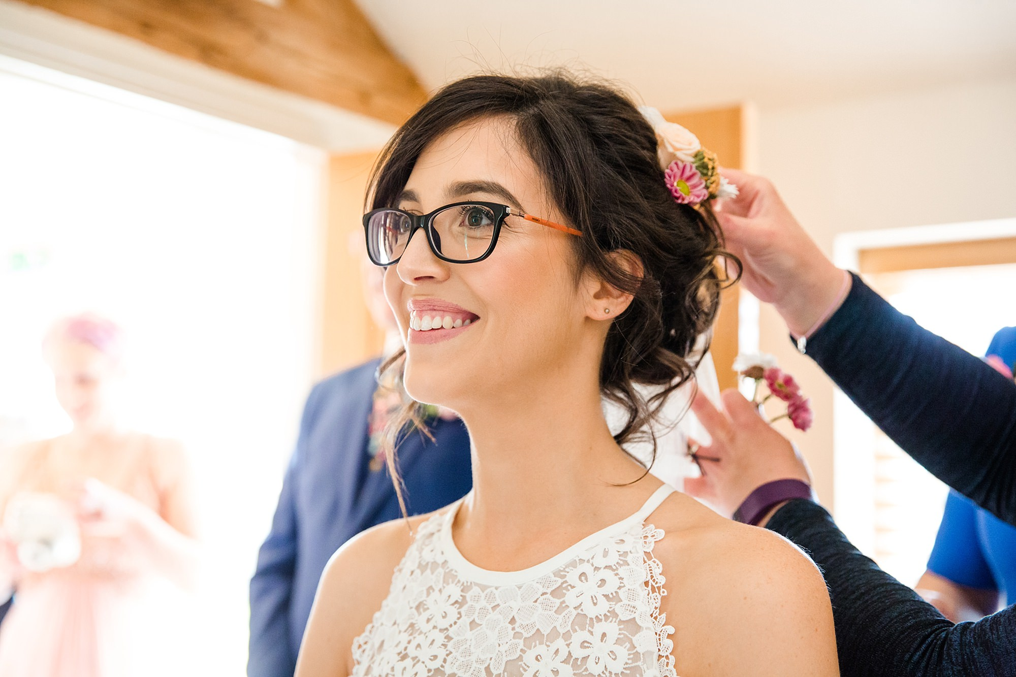 Caswell House Wedding bride has flowers put in her hair