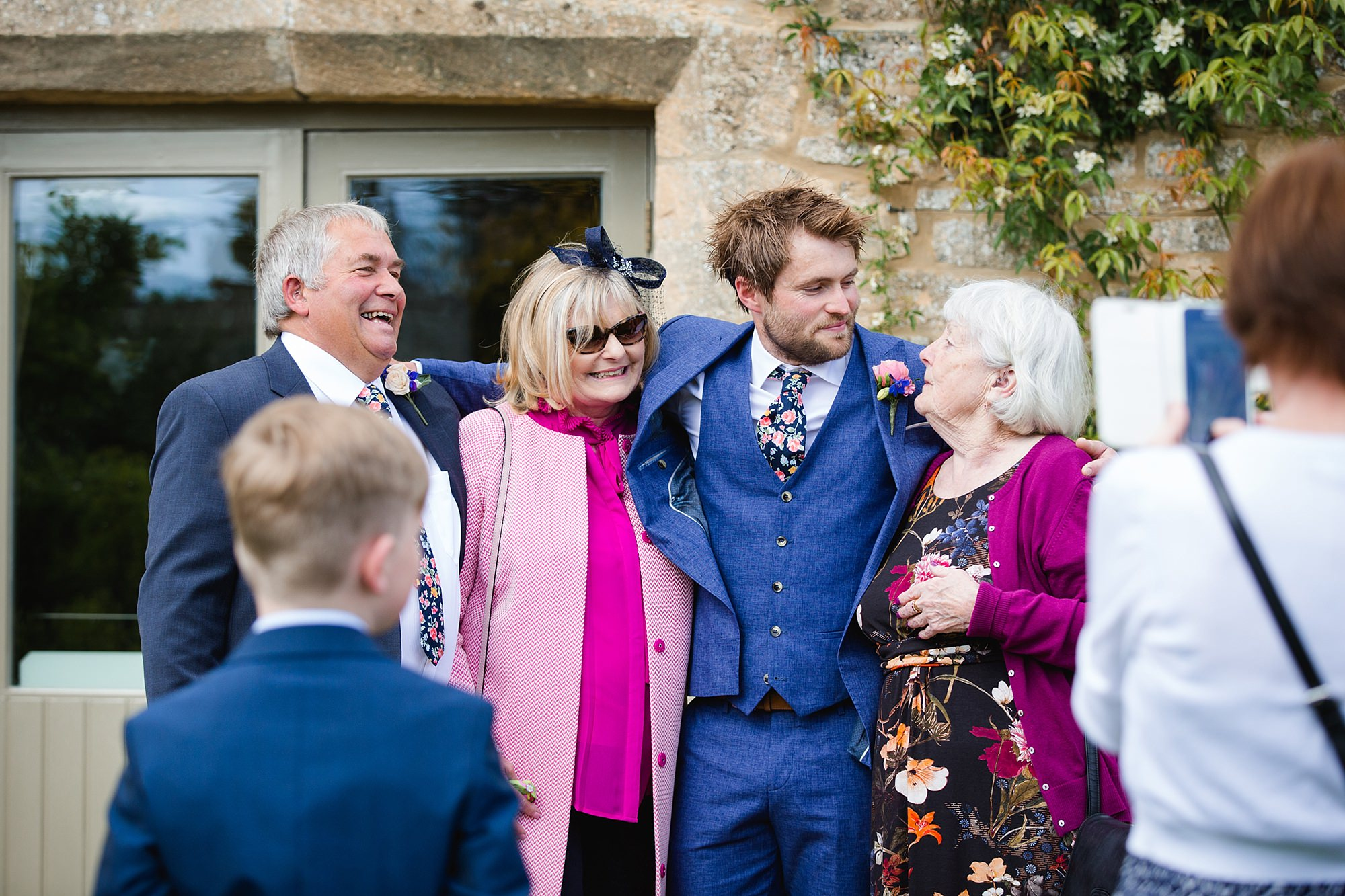 Caswell House Wedding groom waits with his family ahead of ceremony