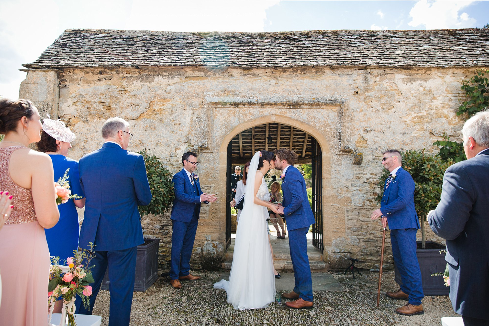 Caswell House Wedding bride and groom first kiss after ceremony