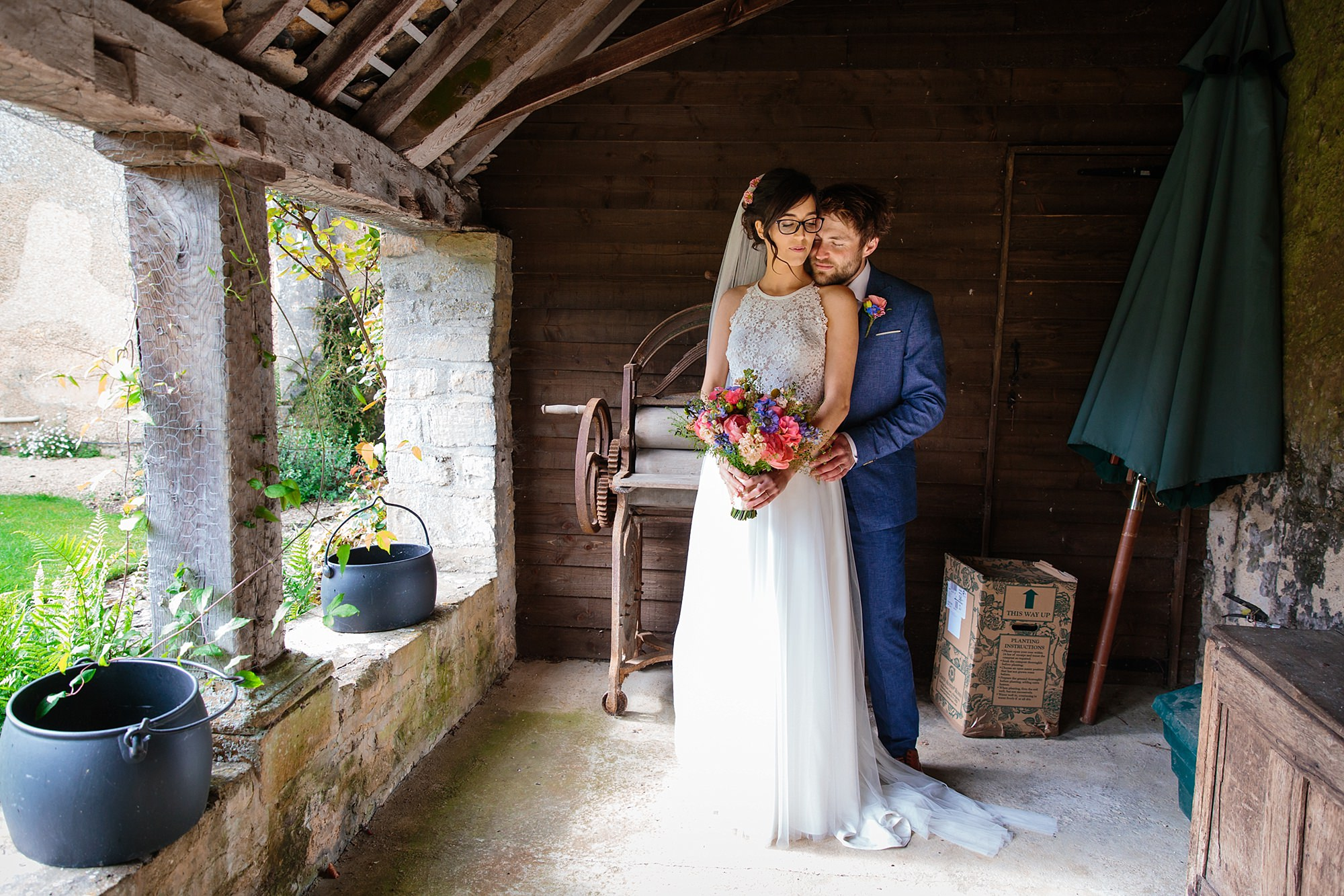 Caswell House Wedding bride and groom together in rustic shed
