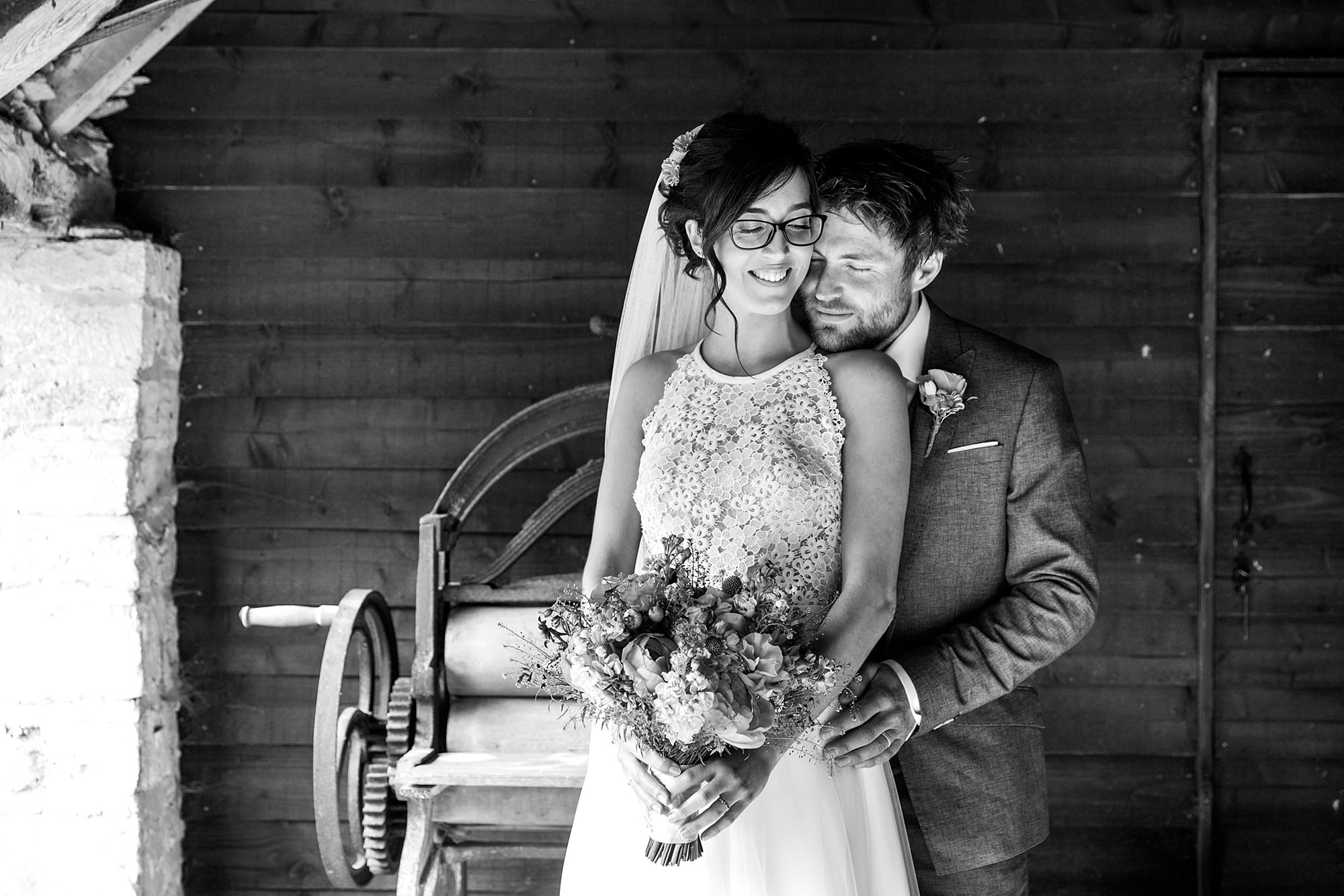 Caswell House Wedding groom and bride together in rustic shed