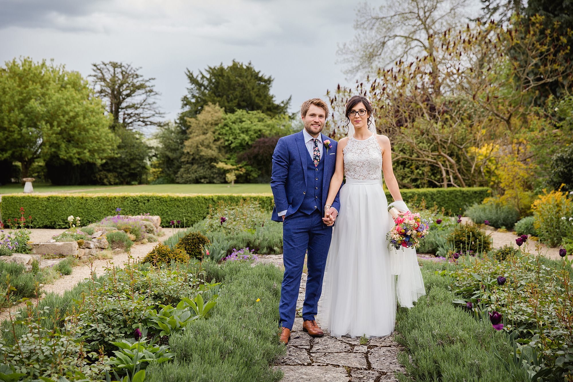Caswell House Wedding bride and groom stand together in the gardens at caswell house