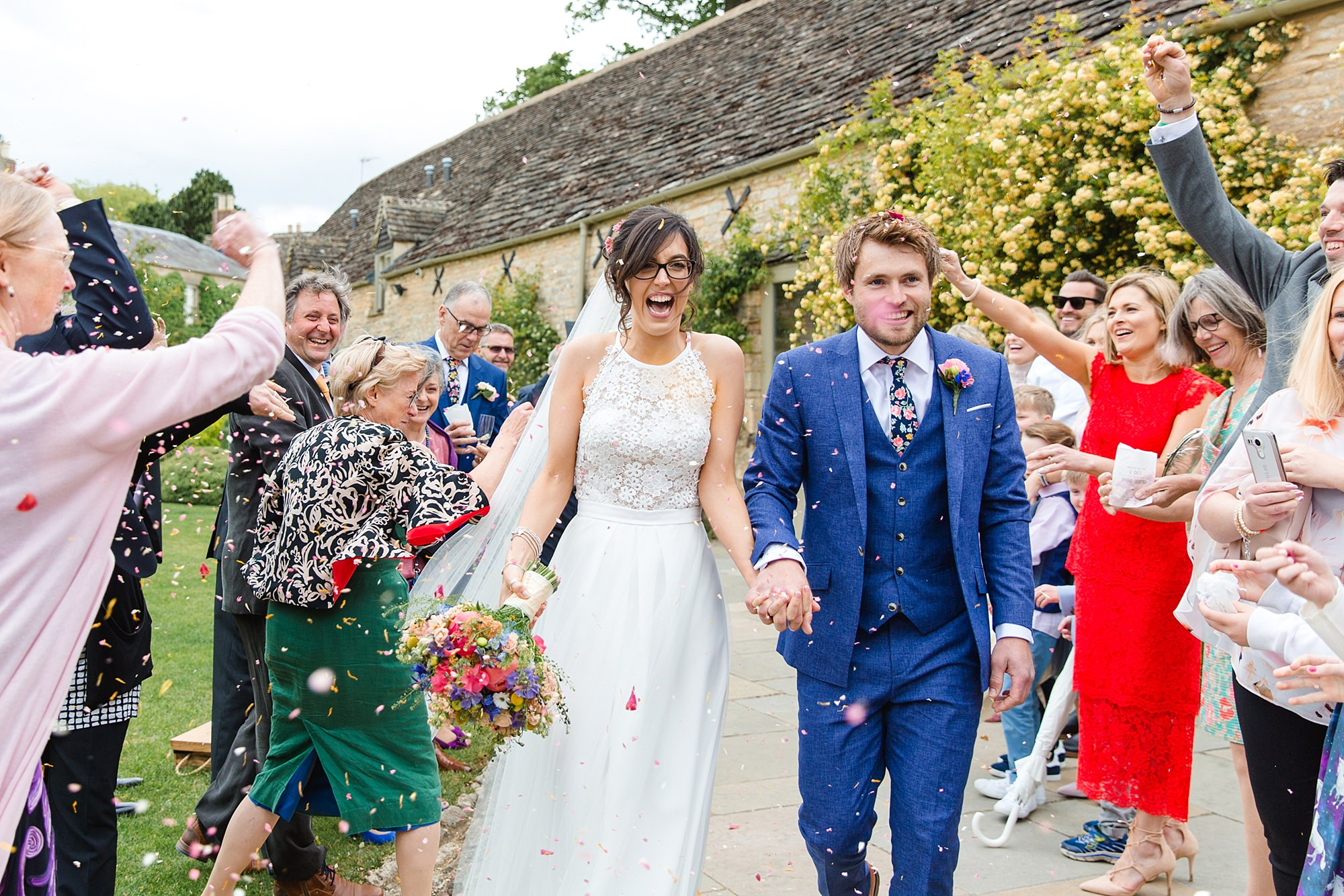 Caswell House Wedding bride laughs as confetti is thrown