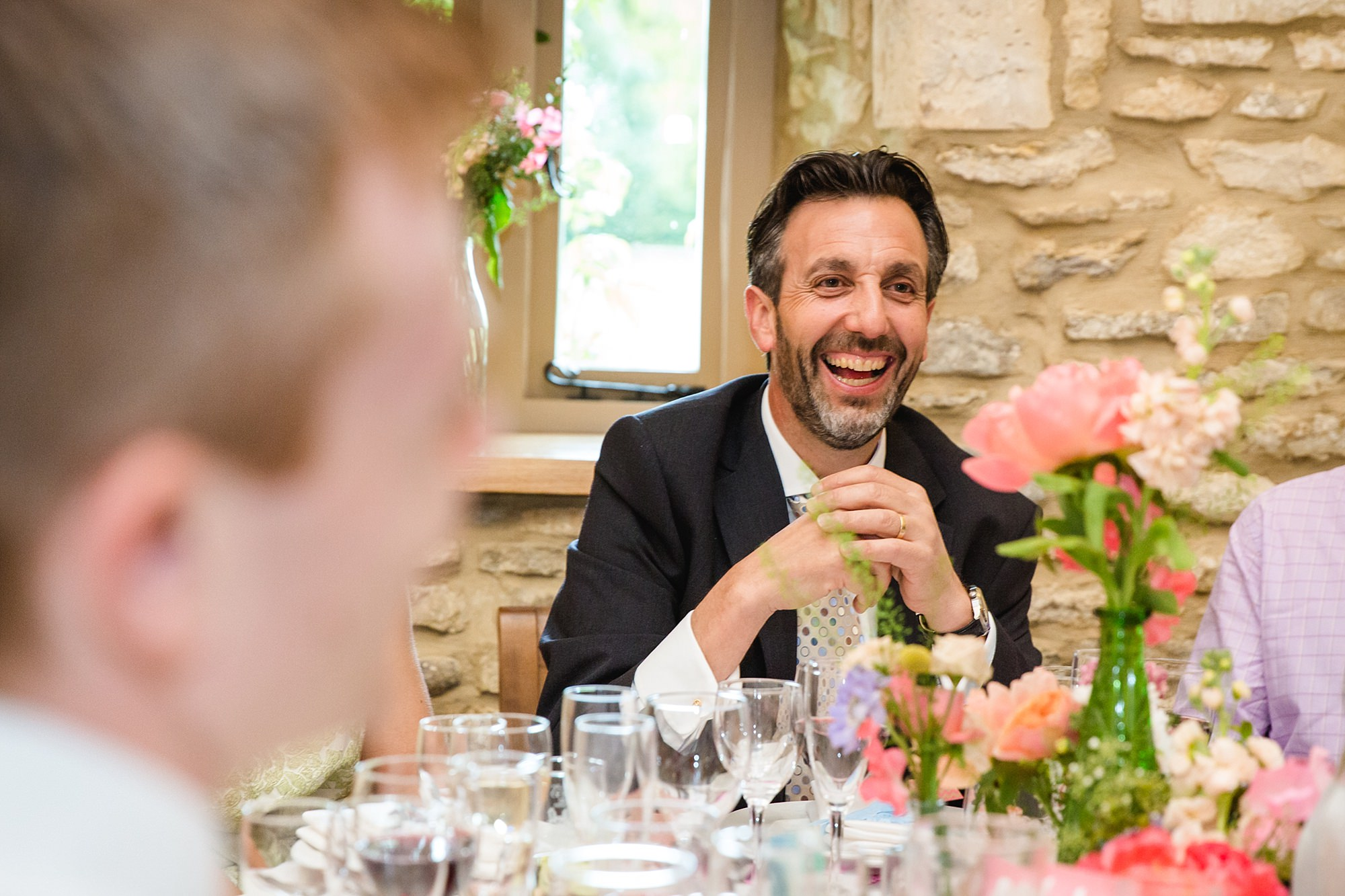 Caswell House Wedding guest laughing during dinner
