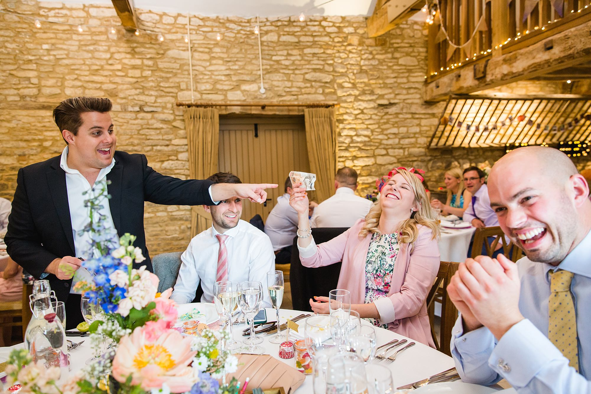 Caswell House Wedding guest laughs at magician's trick