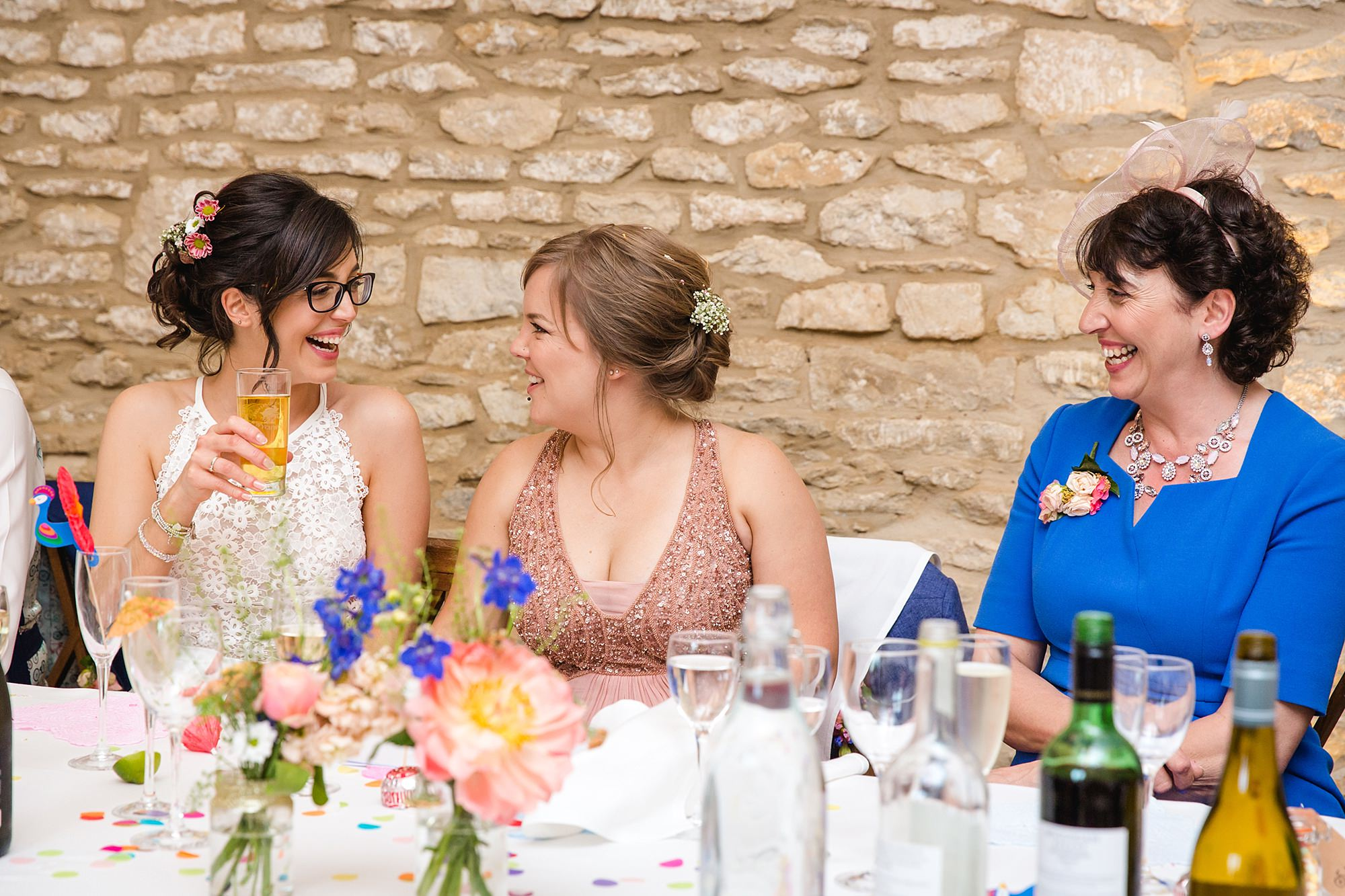 Caswell House Wedding portrait of bride and bridesmaid laughing together