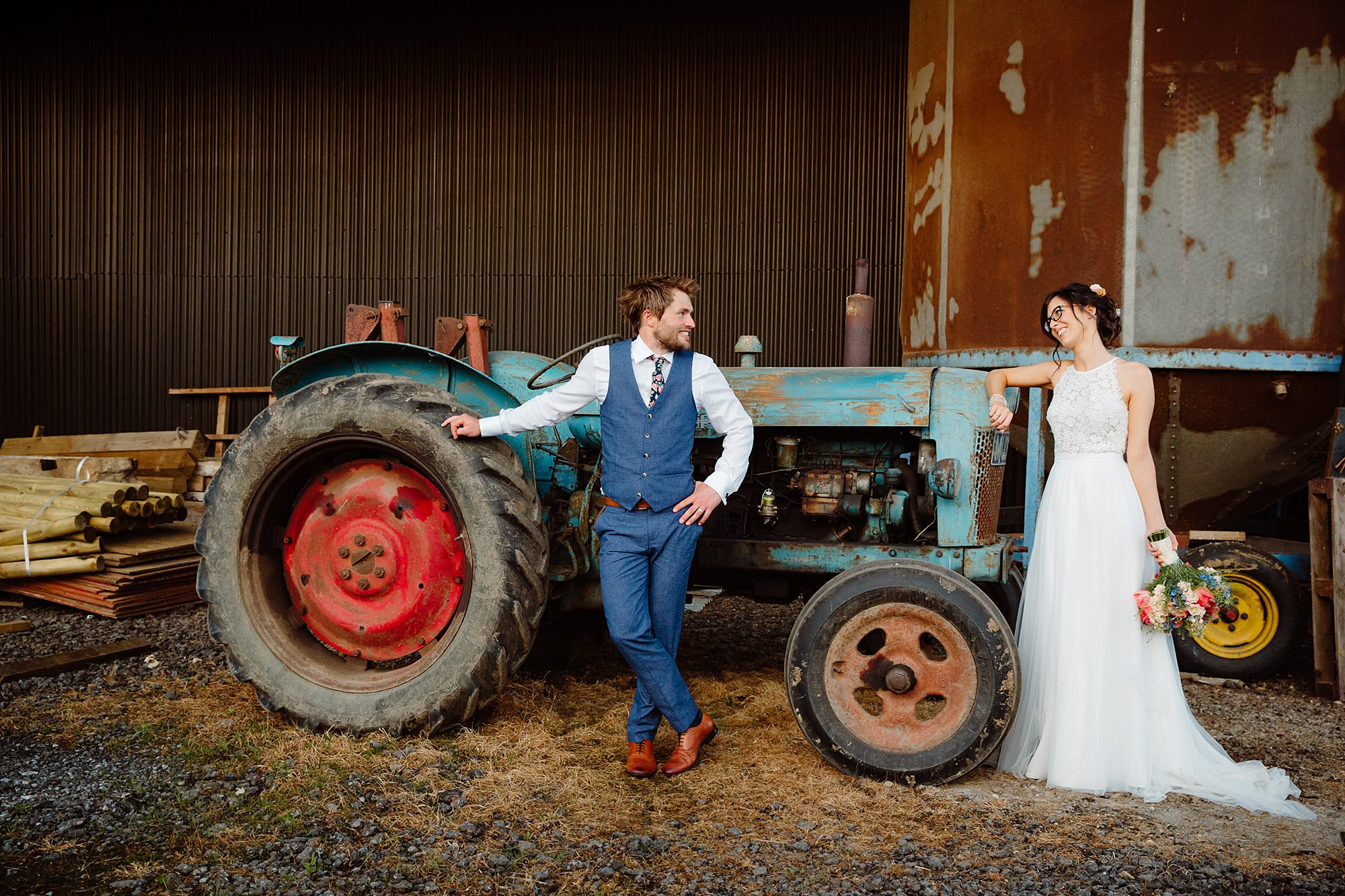 Caswell House Wedding portrait of bride and groom with rustic tractor