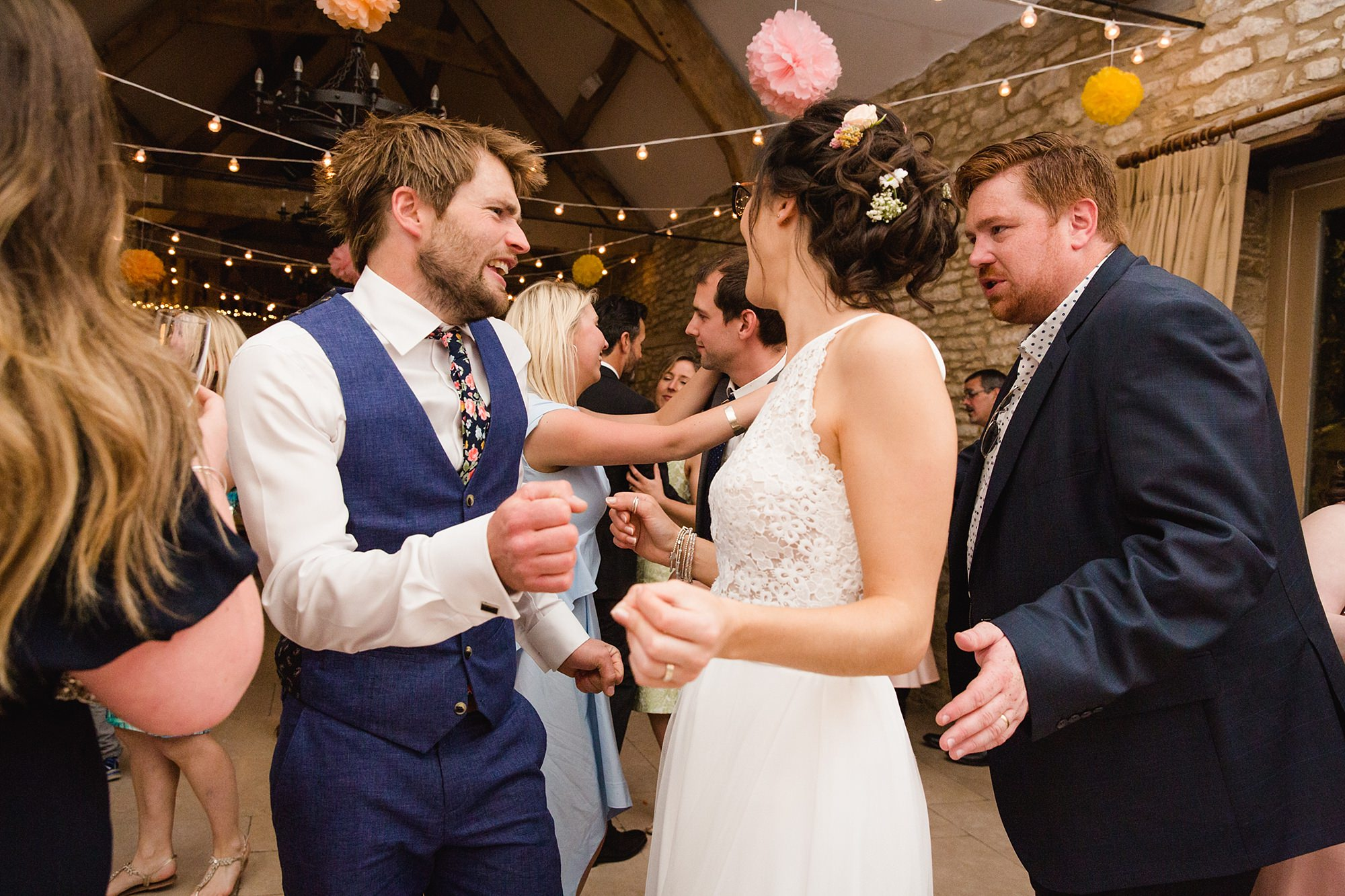 Caswell House Wedding bride and groom dance together with guests