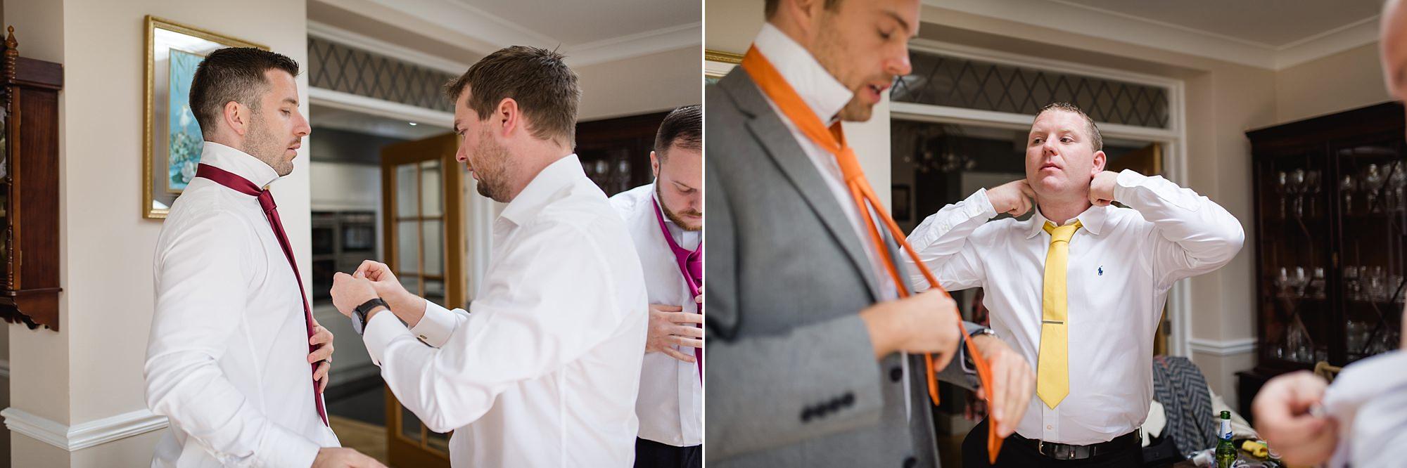 Fun London Wedding portrait of groomsmen tying ties